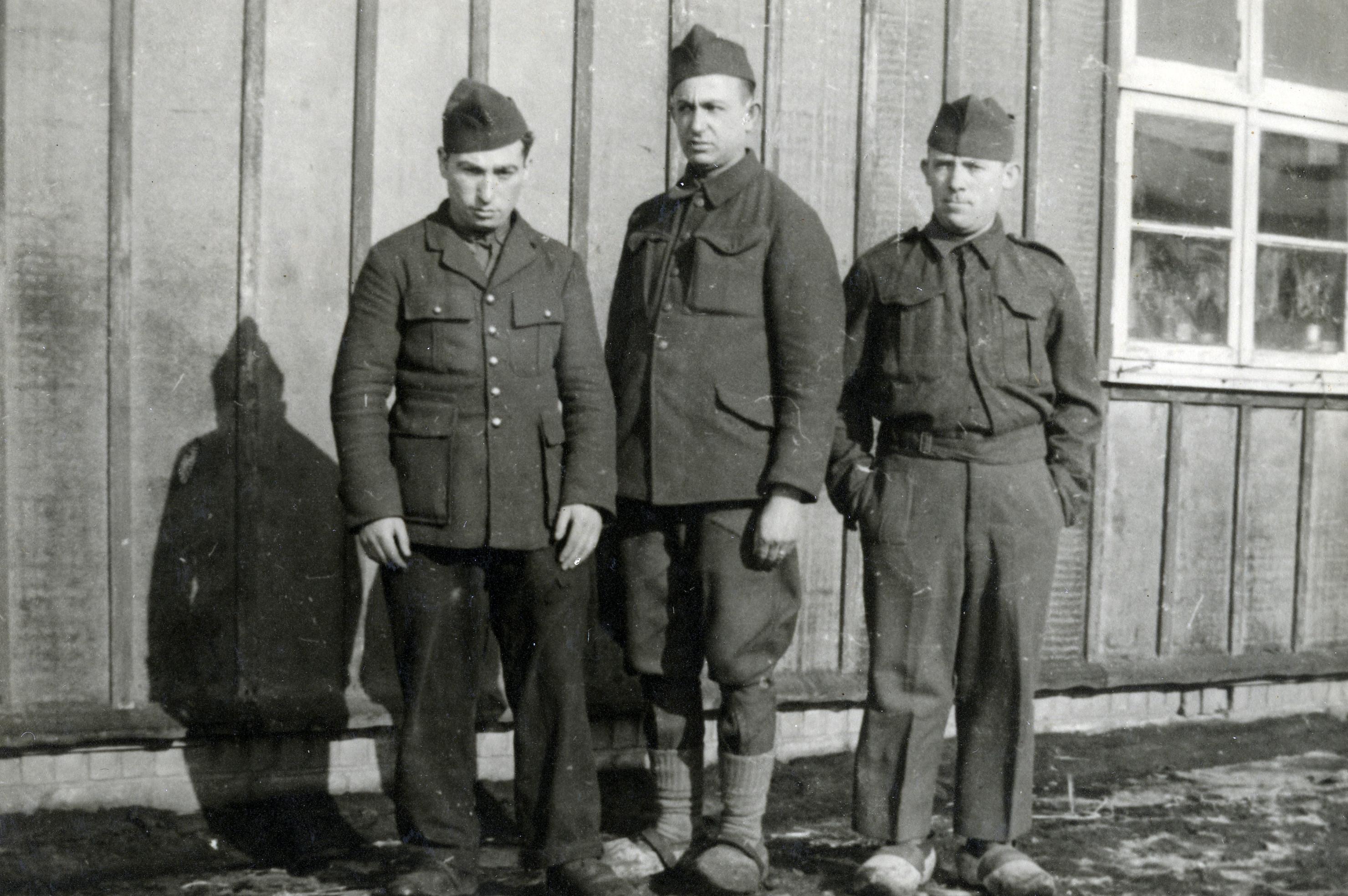 Yaakov Jean Ridnik (center) with two fellow prisoners in a German prisoner of war camp.