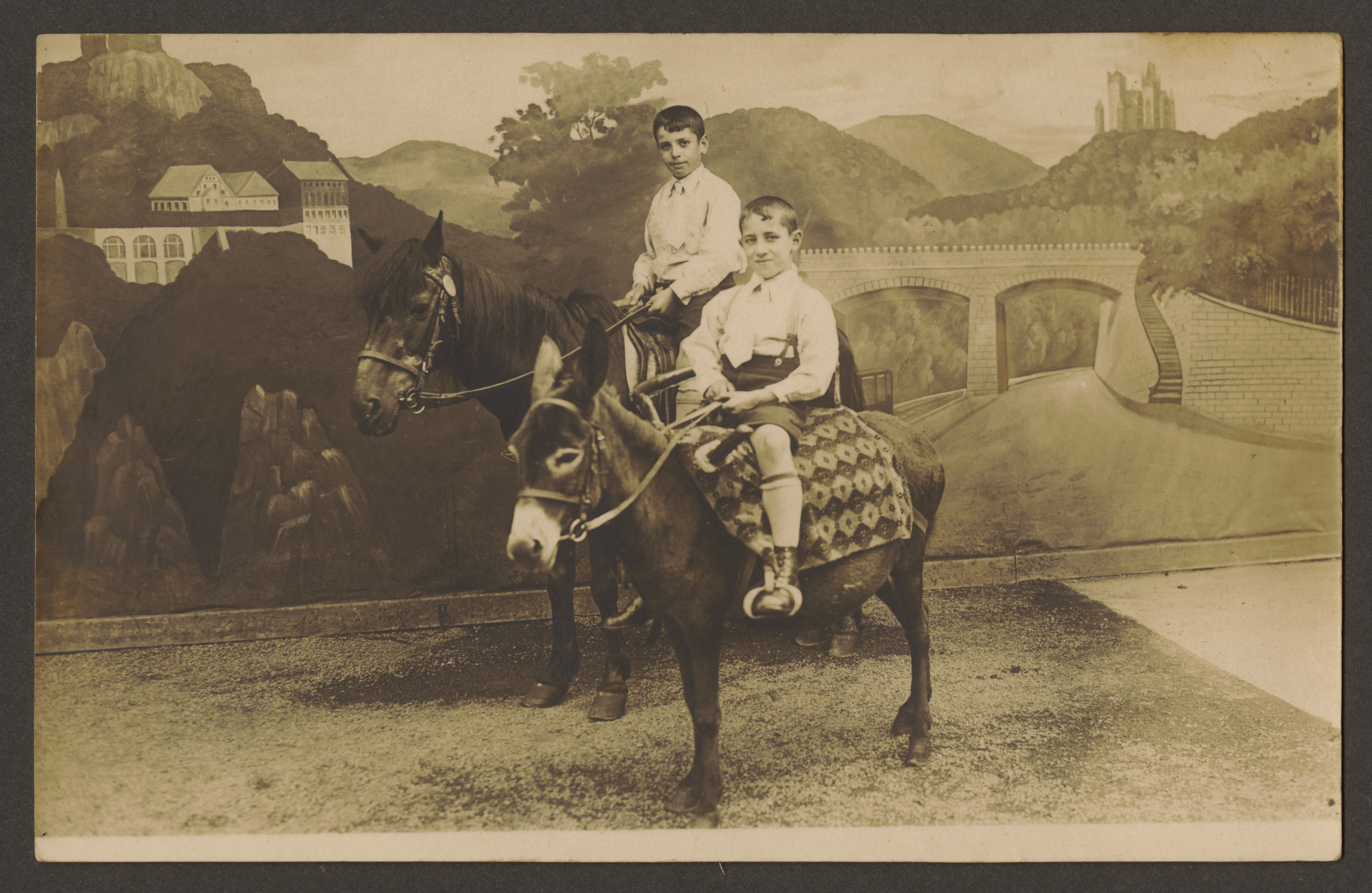 Brothers Helmut and Erich Rosendahl (front) pose for a photograph seated on a horse and a donkey, while on a visit to Mt. Drachenfels.