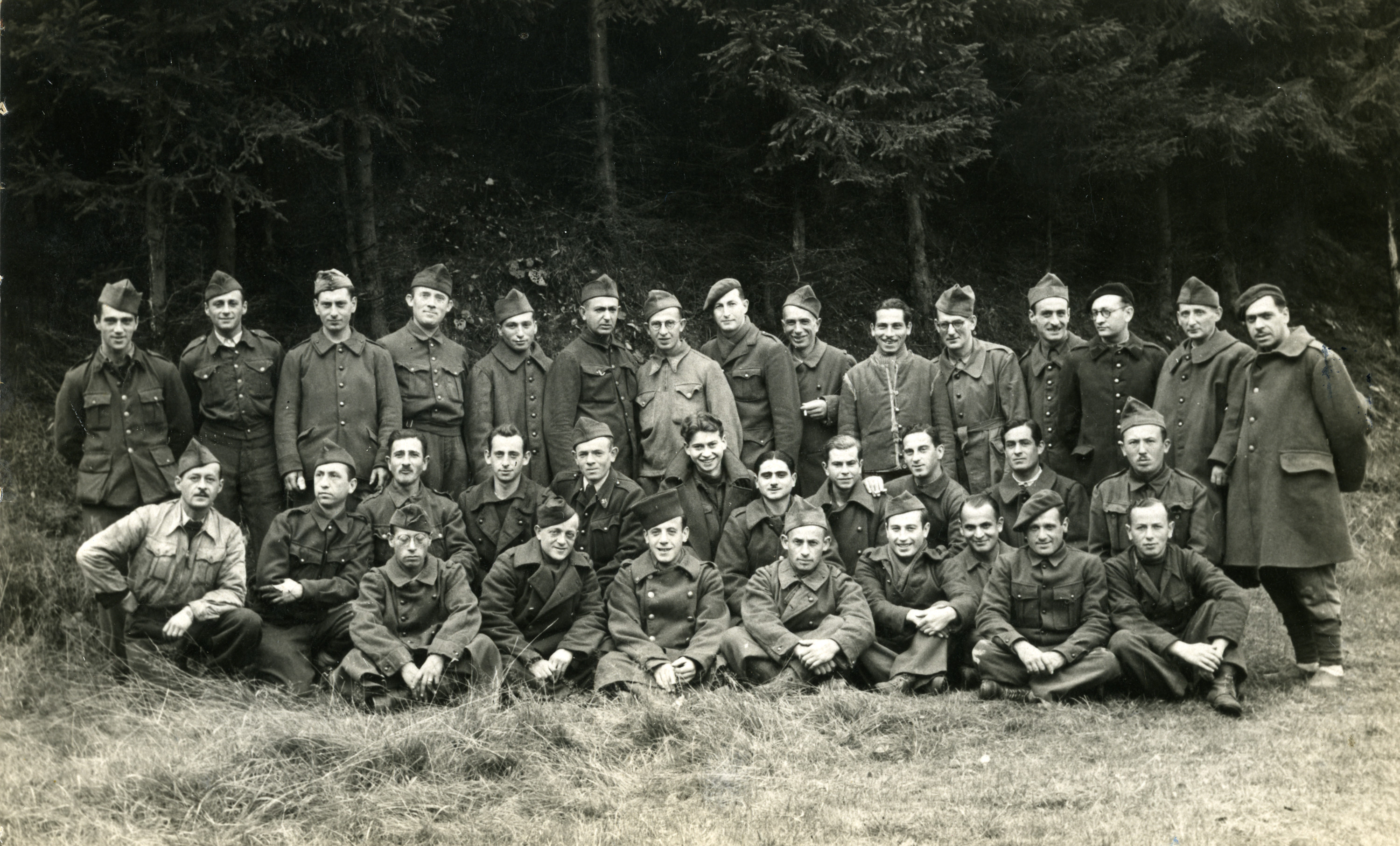 Yaakov (Jean) Ridnik poses with other prisoners in a German prisoner of war camp.  He is pictured standing 6th from the left in the top row.