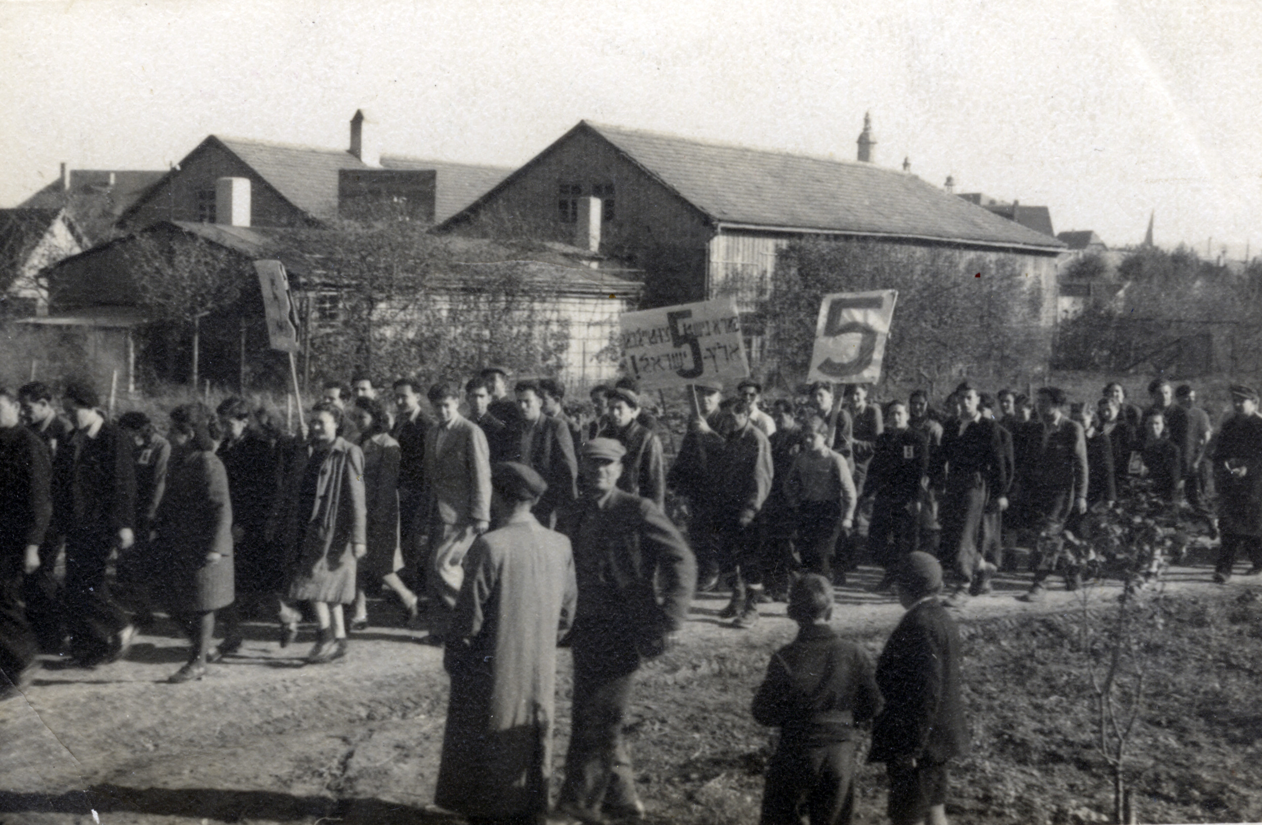 Jewish detainees on the island of Cyprus march in protest of British policies restricting their immigration to Palestine.