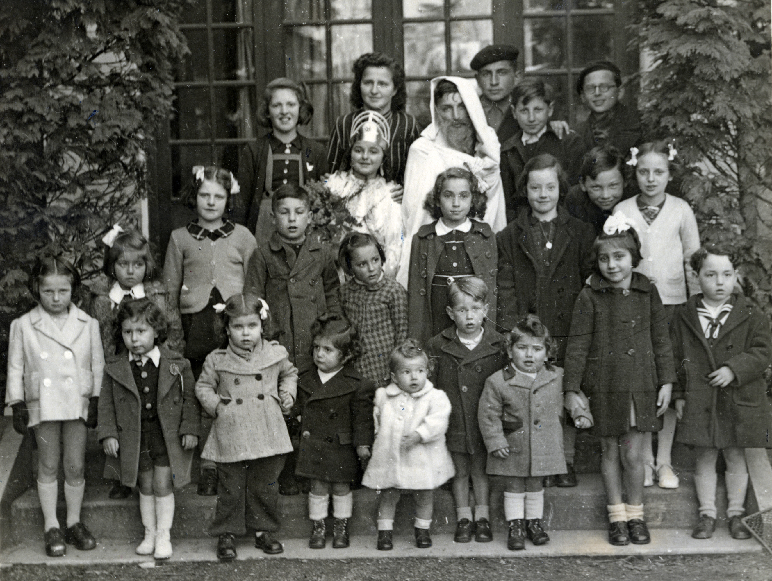Jewish children celebrate Purim, probably shortly after the war.  Claire is in the second row from the back, on the far left, wearing a crown and dressed as Queen Esther.