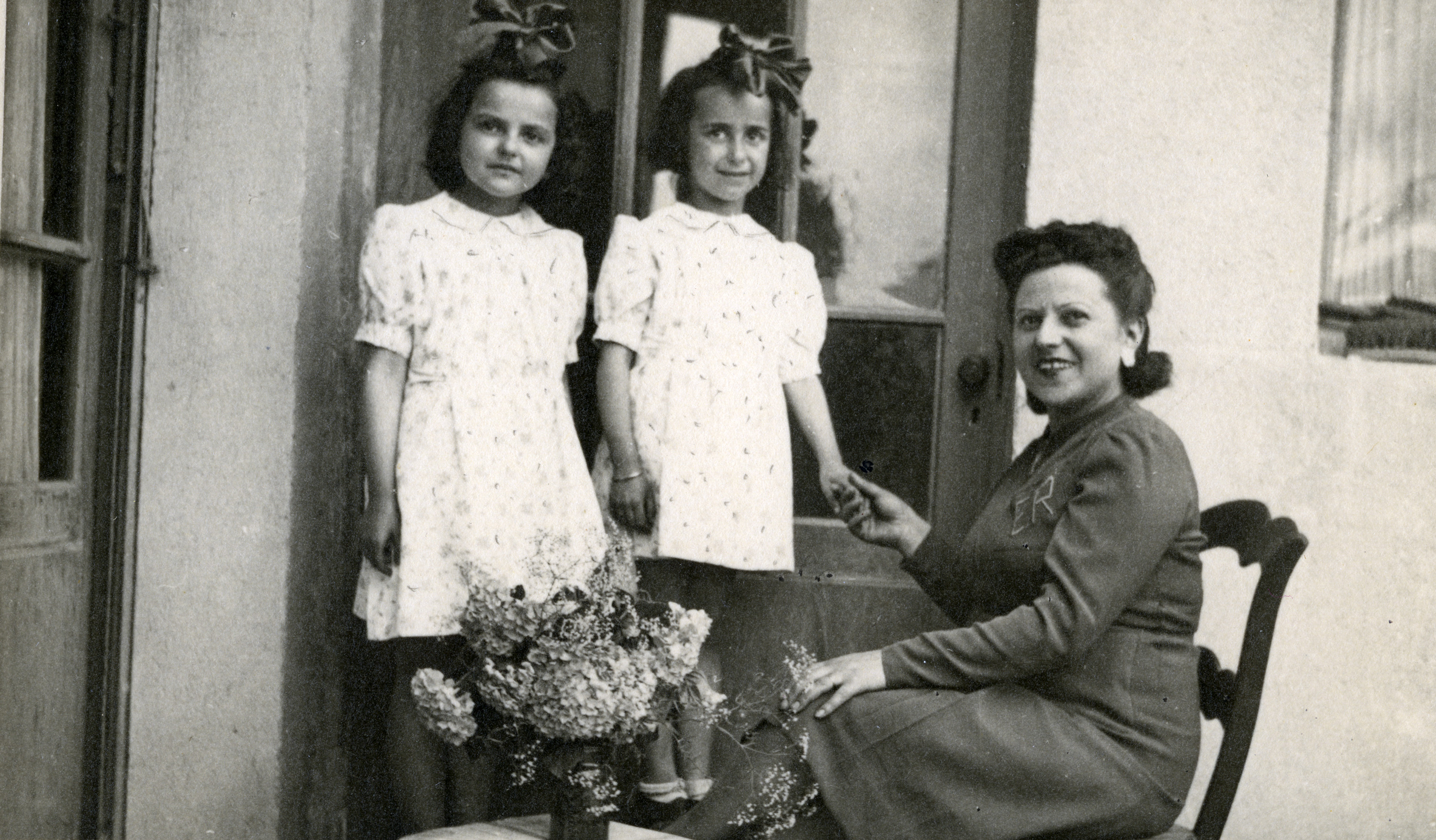 Claire Ridnik, her mother Etla and cousin Aliette pose in their apartment towards the end of the war.