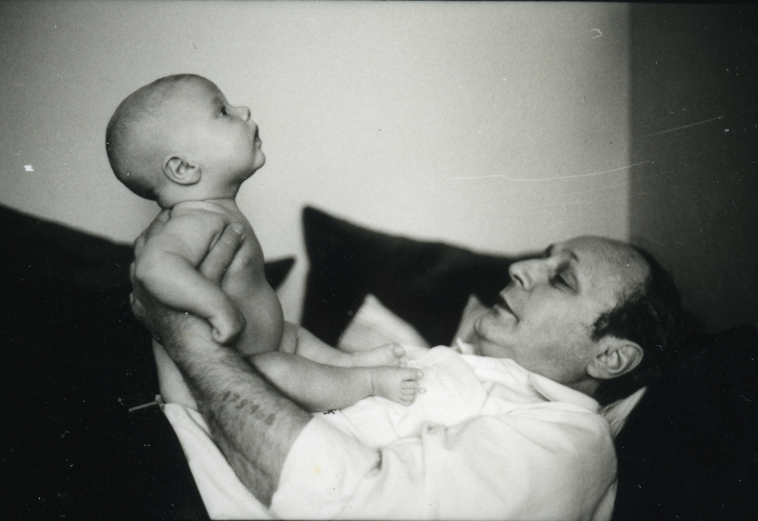 Martin Friedlander holds his first grandchild.