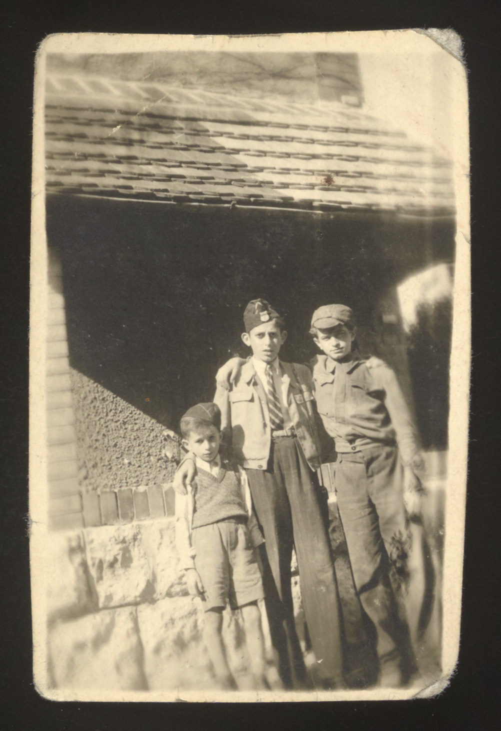 Three Jewish children pose outside after liberation.  Among those pictured is Arthur Spielman.