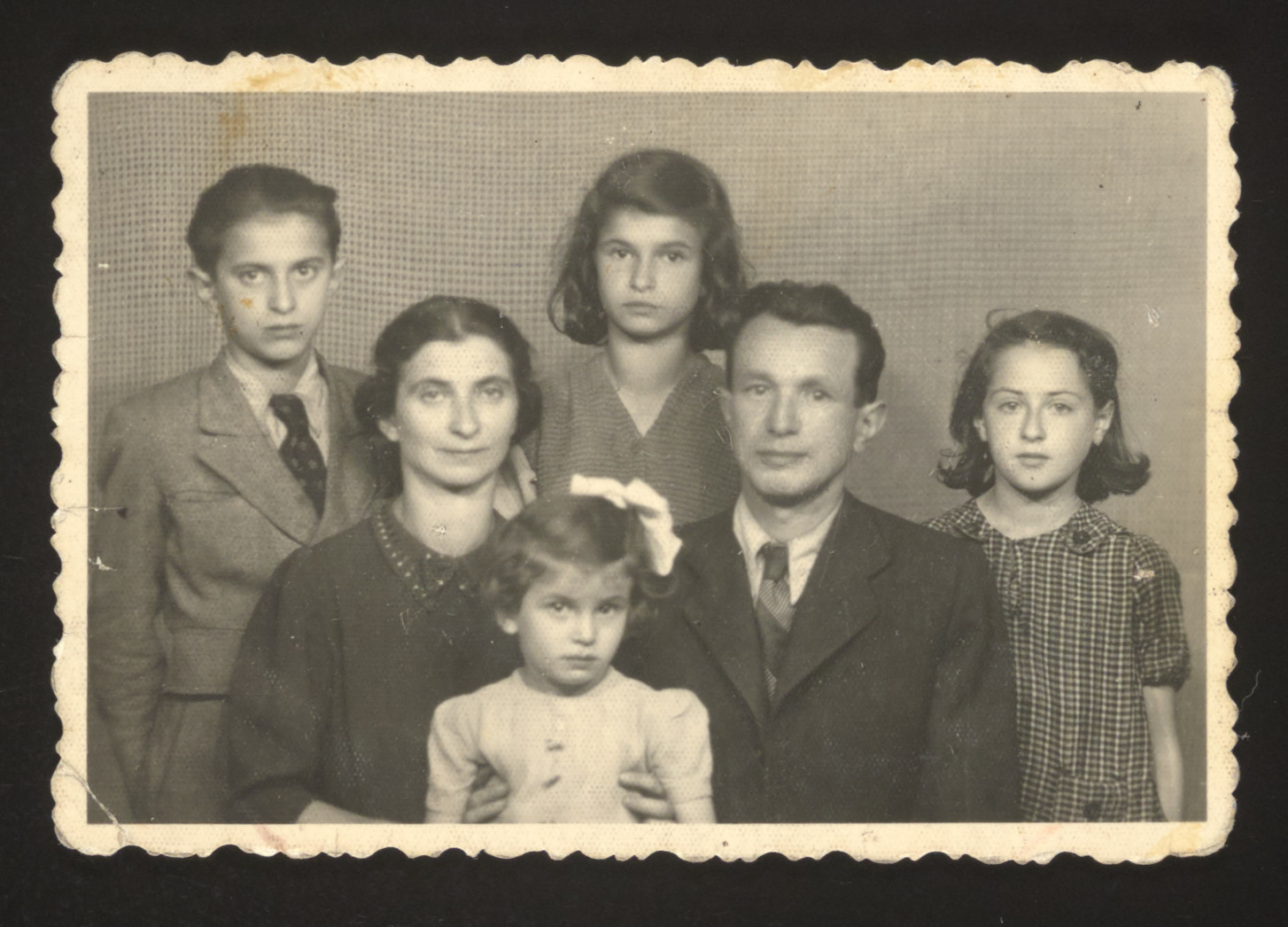 Portrait of a Jewish family in Budapest after liberation.   Pictured from left to right are Arthur, Czarna, Bronia, Henia, and Simon Spielman and their cousin Miriam Galitzer.