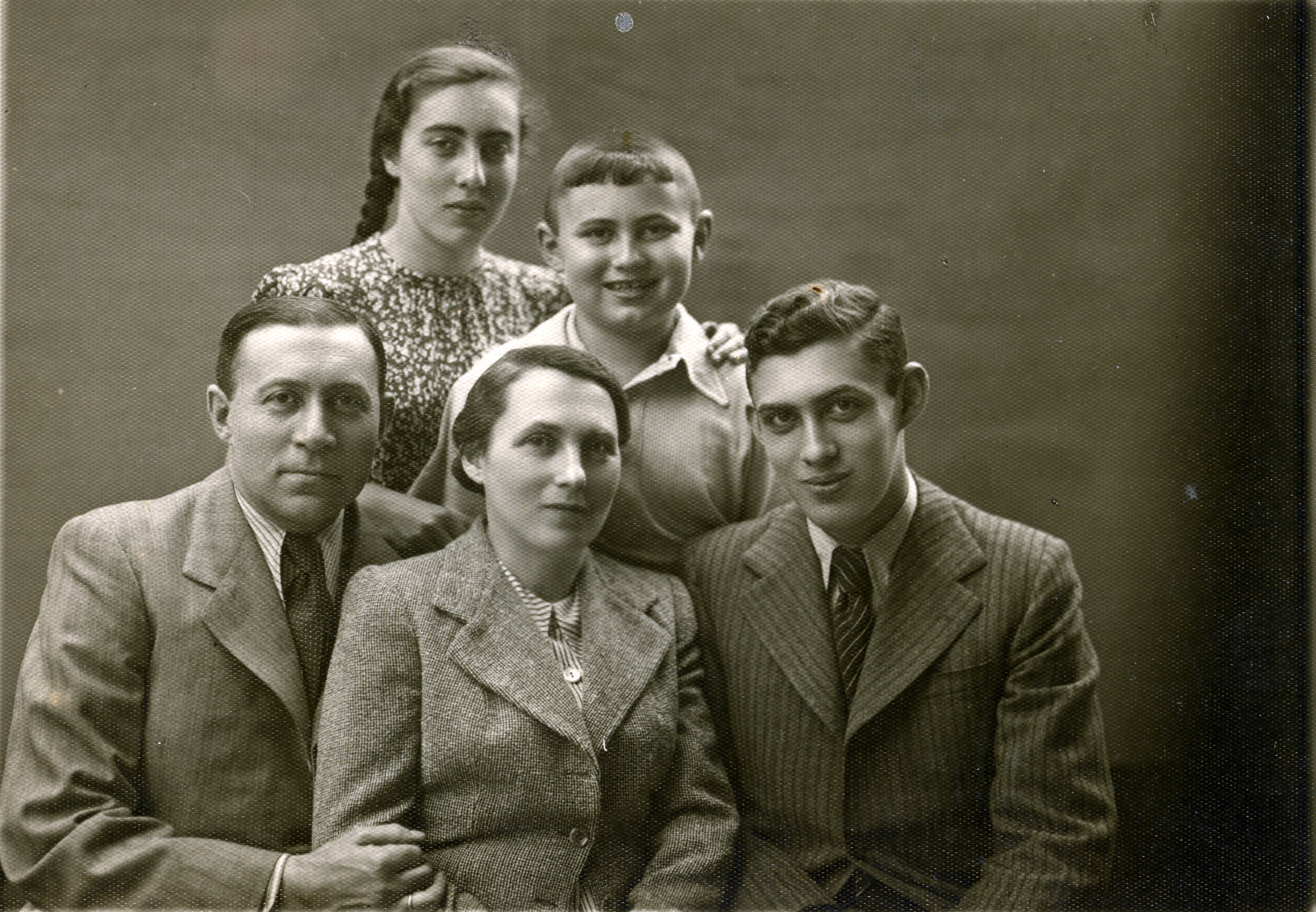 Studio portrait of a Jewish family in Kalisz, Poland.  Pictured are Hersz and Rachel Gluba, with their children Ester, Michael, and Szamszon.