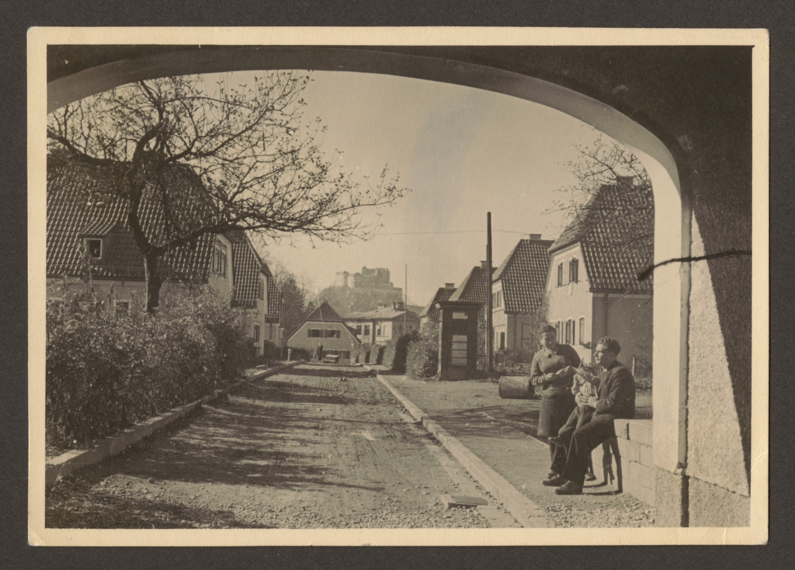 Manya Blacher and an unidentified man pose under an archway in Salzburg [perhaps on their way to Germany].