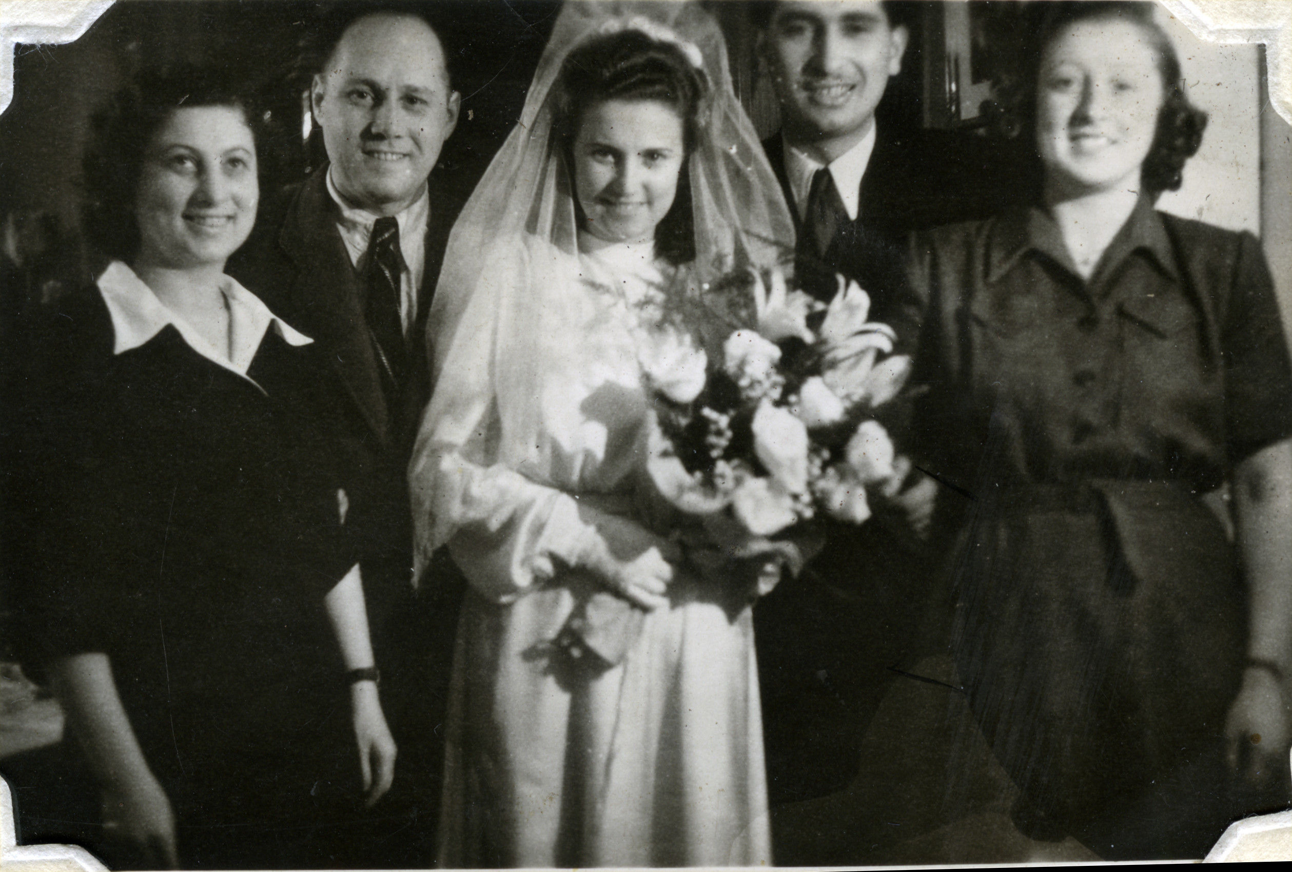 Wedding of Czech Jewish survivors in Podmokly, Czechoslovakia.  Pictured (left to right) are Matilda (nee Scheiner) and her husband Beila, Bella (nee Scheiner) and her husband David Perl, and Manci Scheiner.
