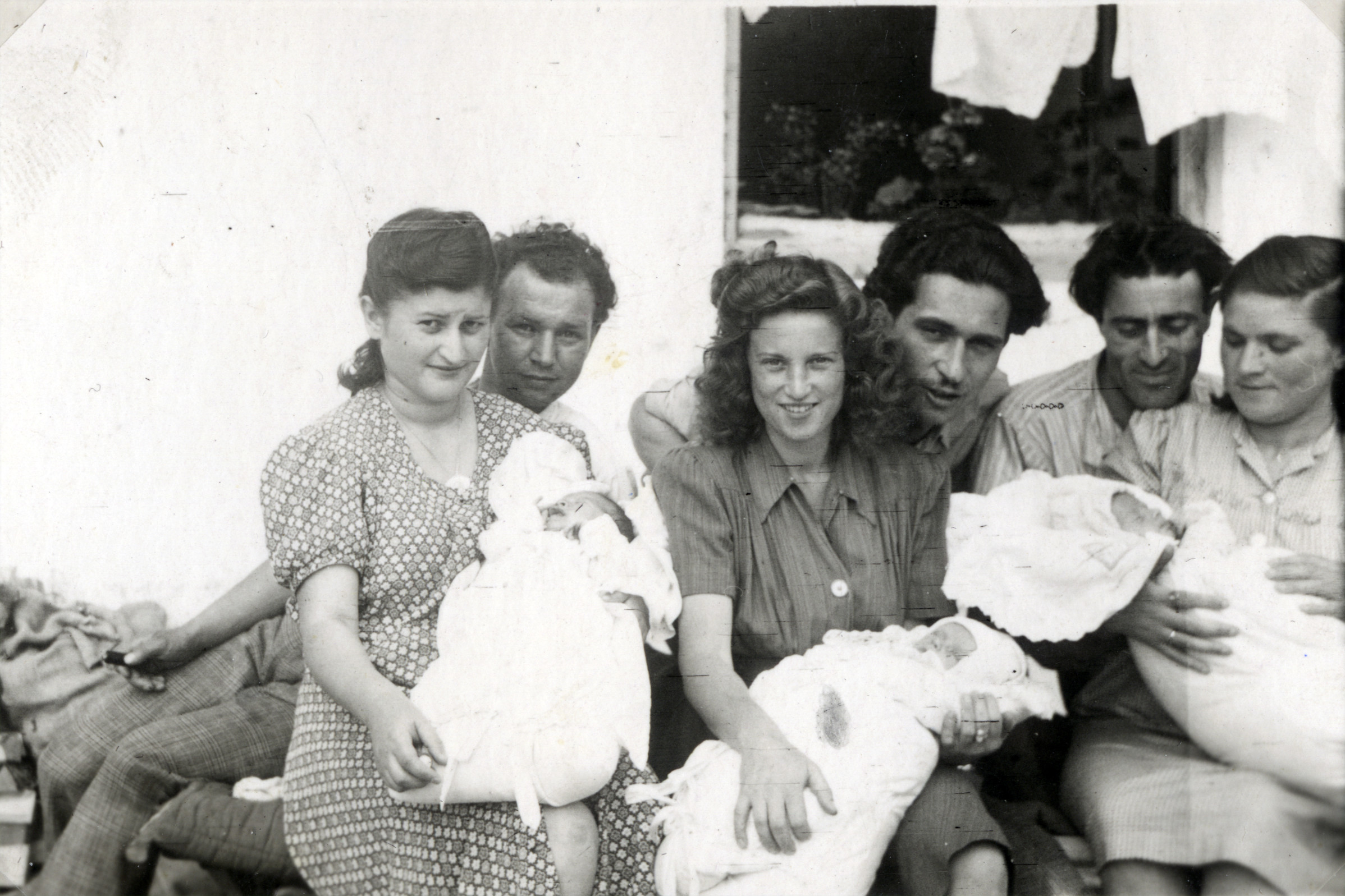 Couples with their new babies in the Gabersee displaced persons camp.  Among those pictured are David and Bella Perl with their daughter Rachel (center).