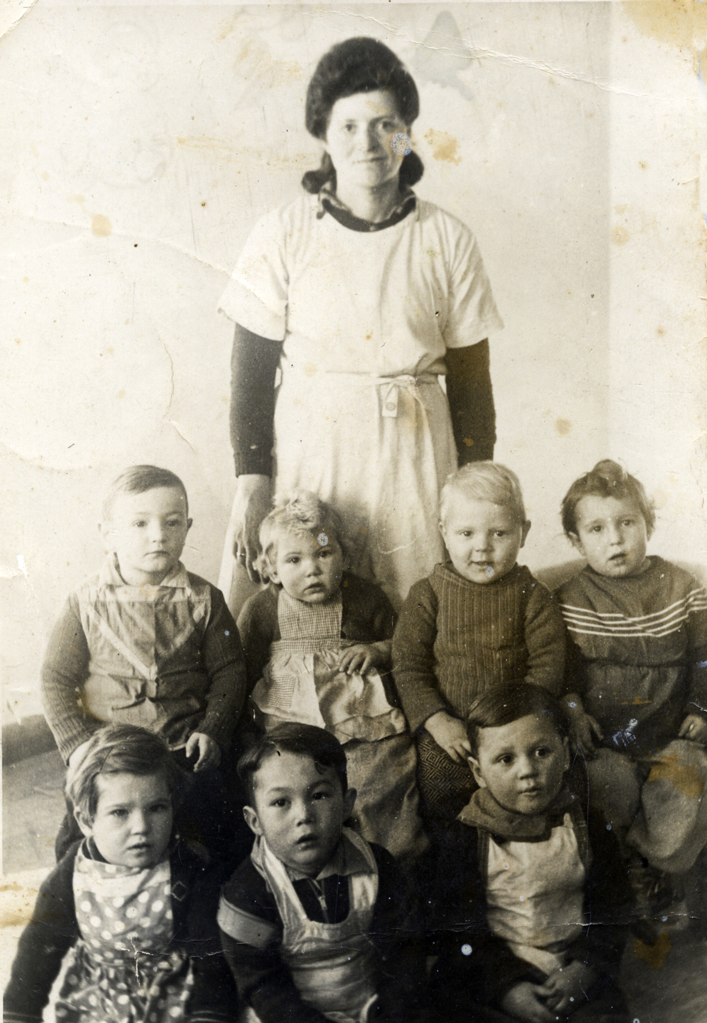 A group of toddlers and their caretaker at the Bergen-Belsen displaced persons camp.  Among those pictured are Zippy Orlin (standing in back), Illana Millman (back row, second from left) and Izak Szewelewicz (back row, third from left.)