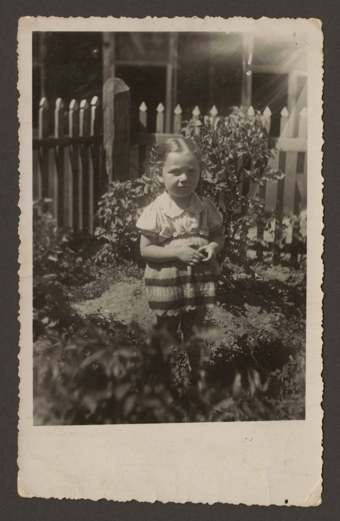 Minna Katz stands in her garden in prewar Lithuania.  She was the daughter of Yizhak and Manya Blacher Katz and half-sister of the donor.  Minna Katz died of medical complications shortly after the German invasion.