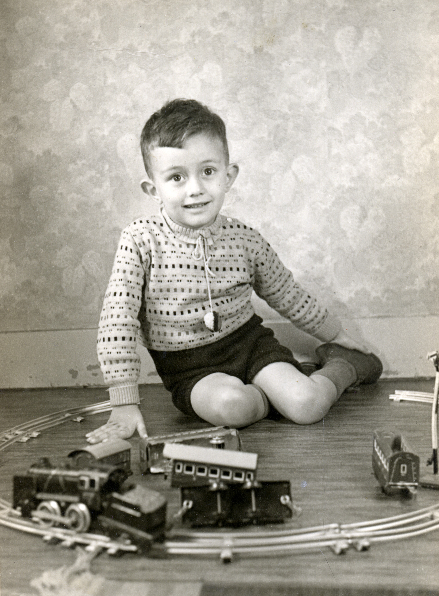 Portrait of Louis Polak with a toy train set, taken prior to going into hiding.