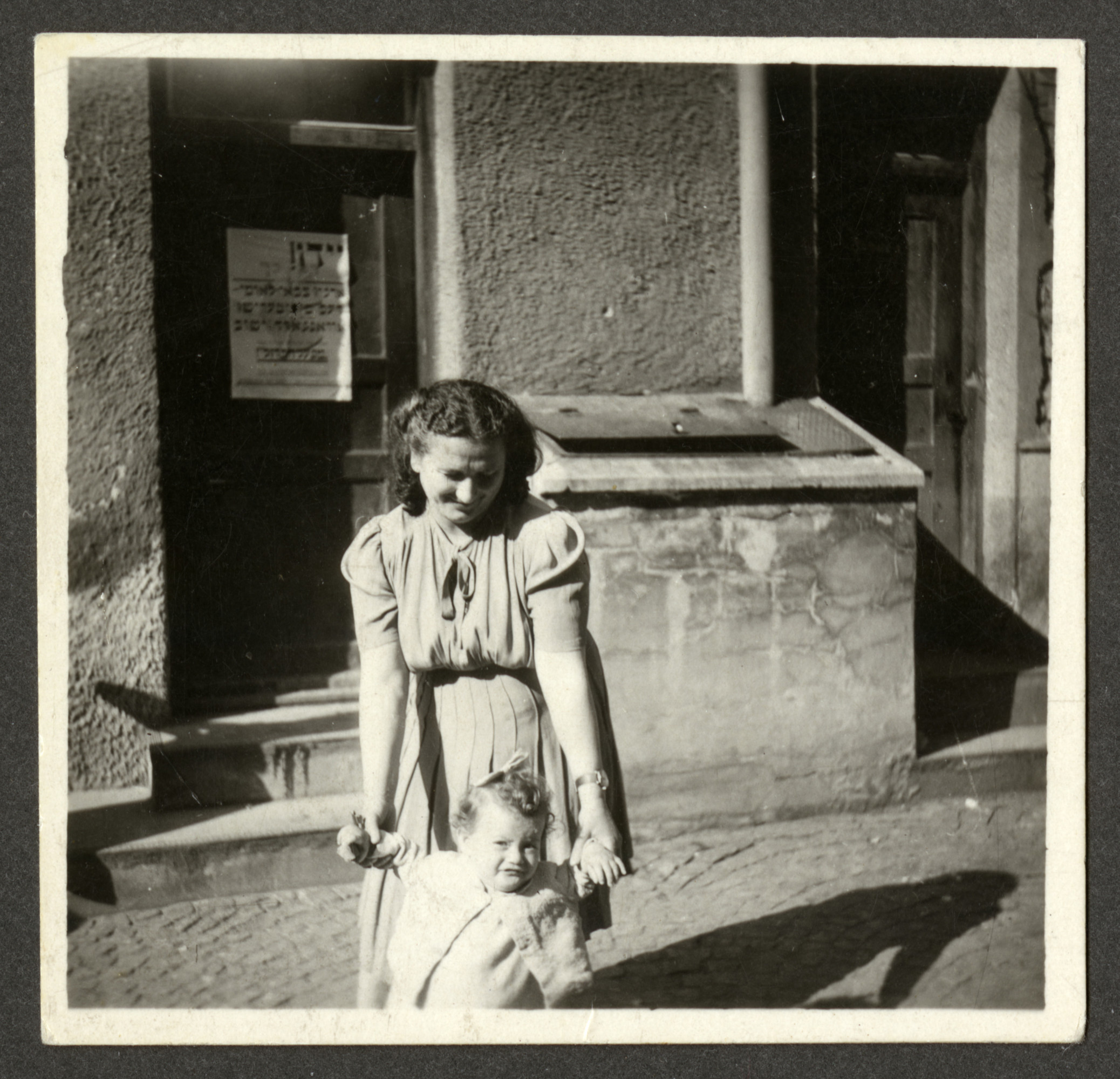 Manya Kirstein poses with her baby daughter Sara [possibly in the Weilheim displaced persons camp].