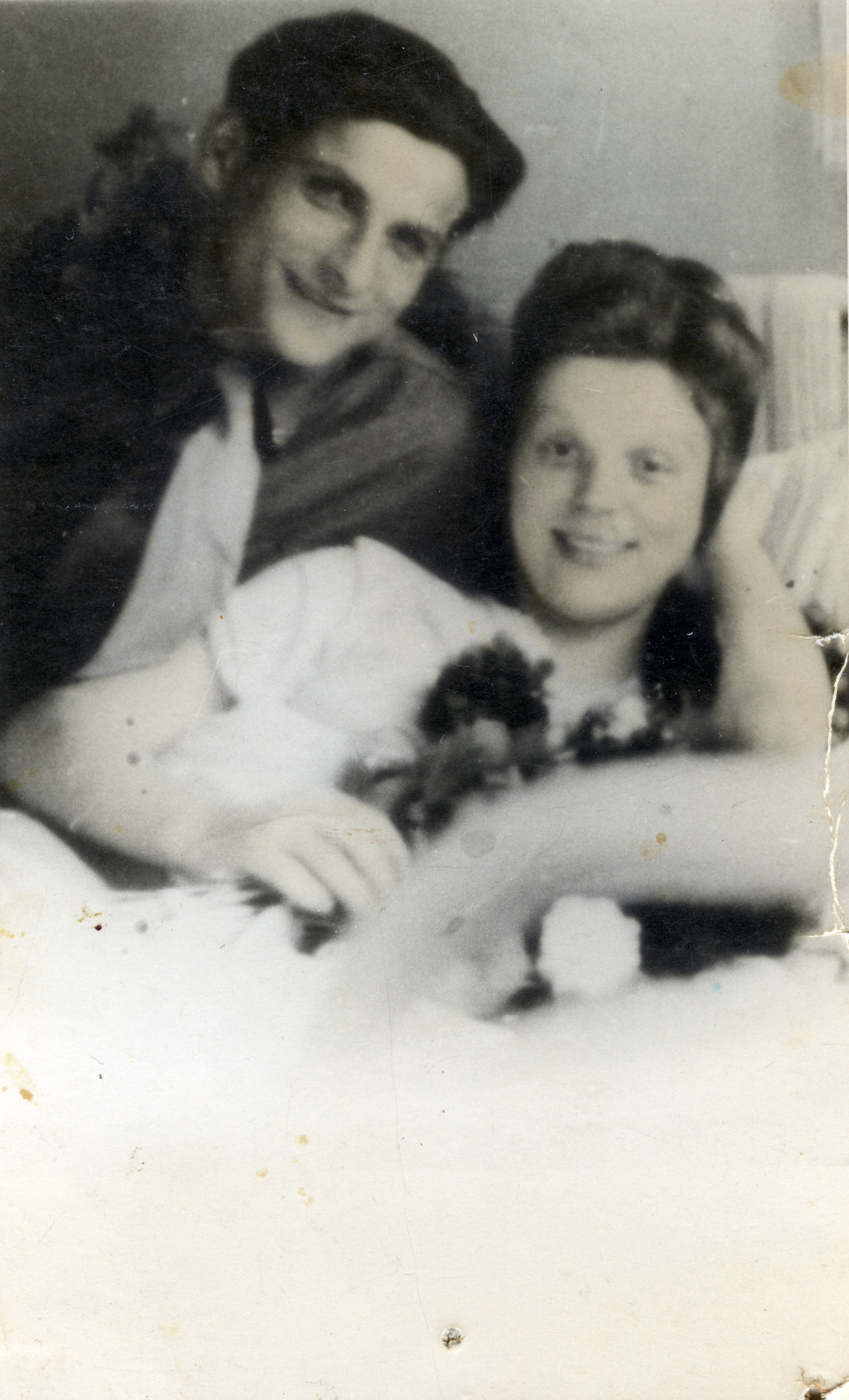 """A couple in the Bergen-Belsen displaced persons camp, after the birth of their son.  PIctured are Grisza and Aida Szewelewicz, after the birth of Szepsyl (""""Shep"""")."""