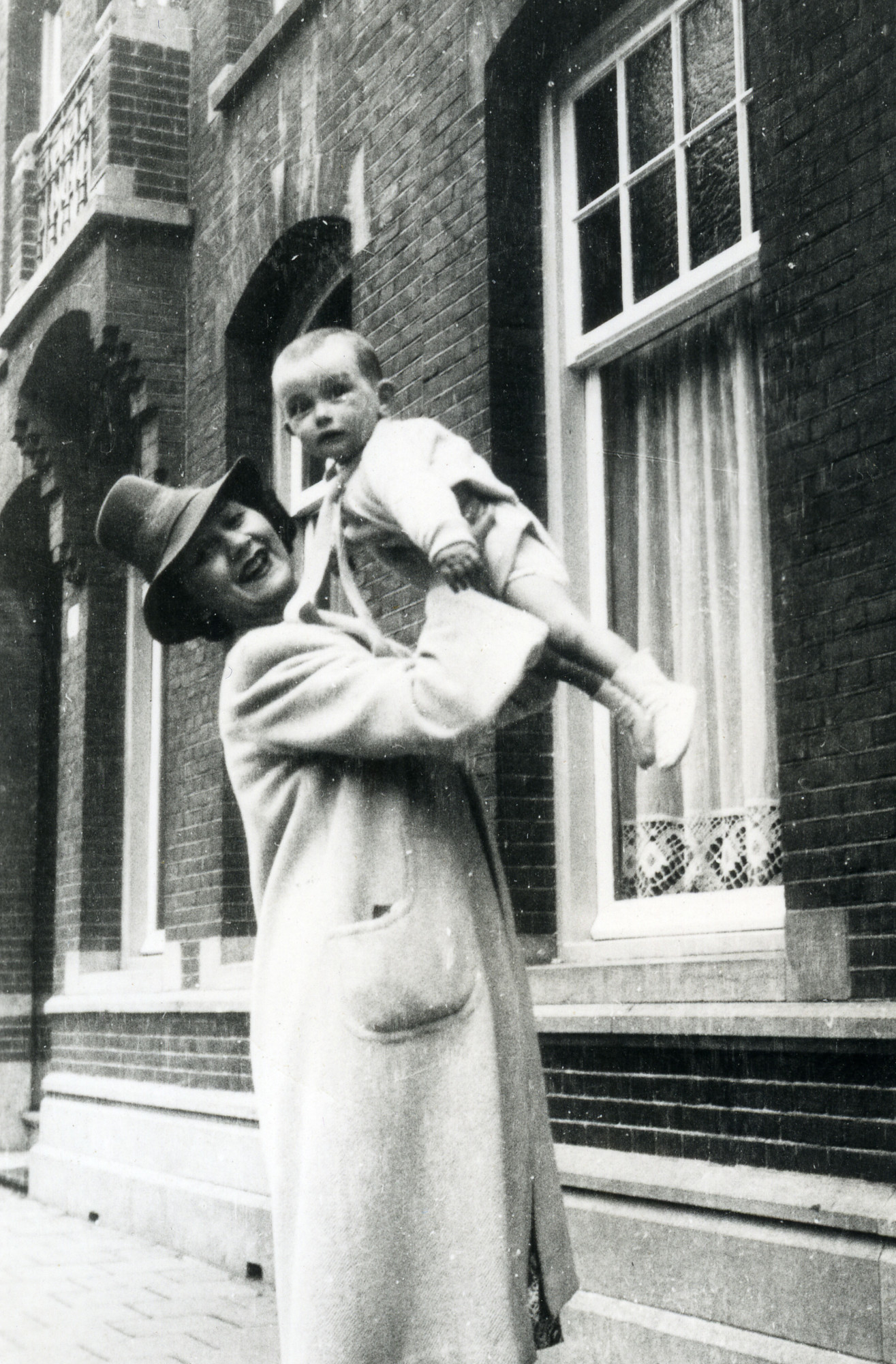 Esther Polak lifts up her baby nephew Louis Polack.  Esther did not survive the Holocaust