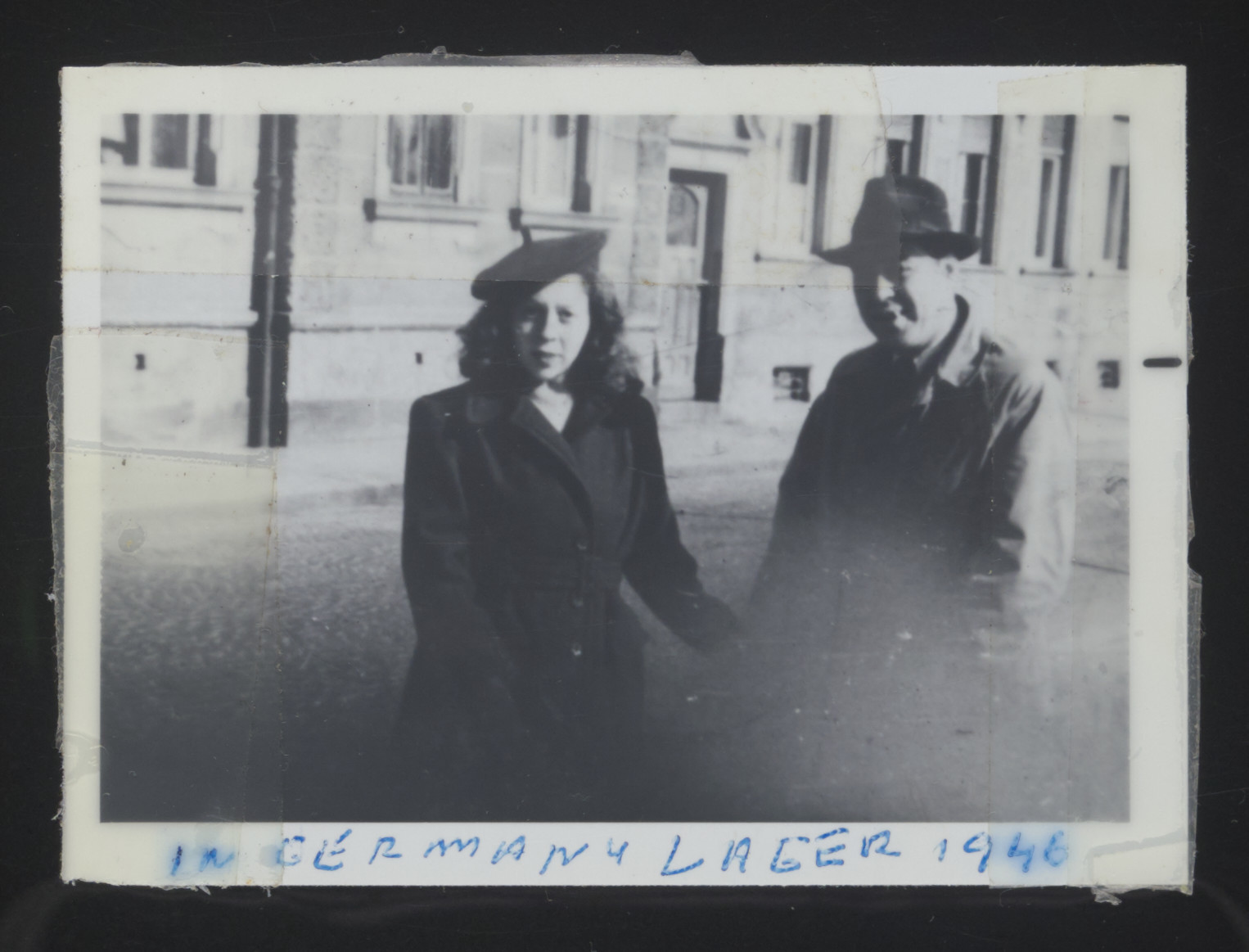 Magda and Andre Bernat stand before an unidentified exterior in Bamberg, Germany.