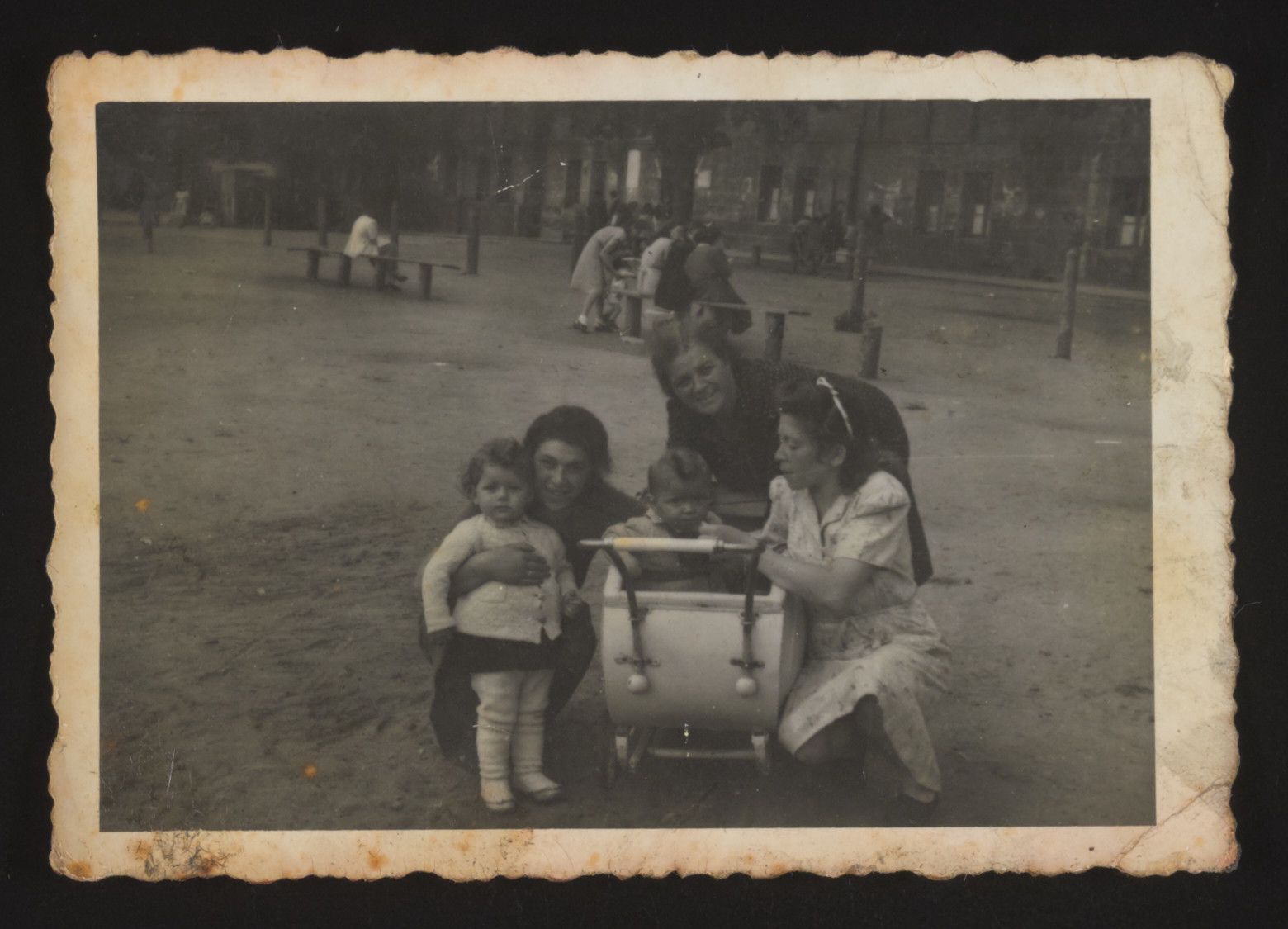 Women and children pose for a photograph in the Bamberg displaced persons camp.   Magda and Stephen Bernat are first and second from right.