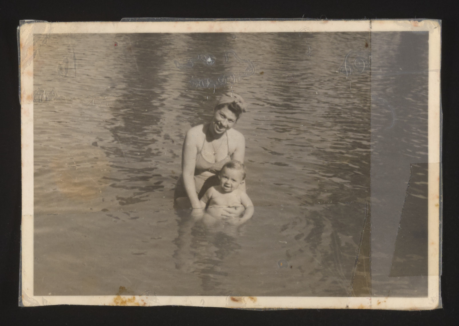 Ibolya and Stephen Bernat pose for a photograph while swimming.