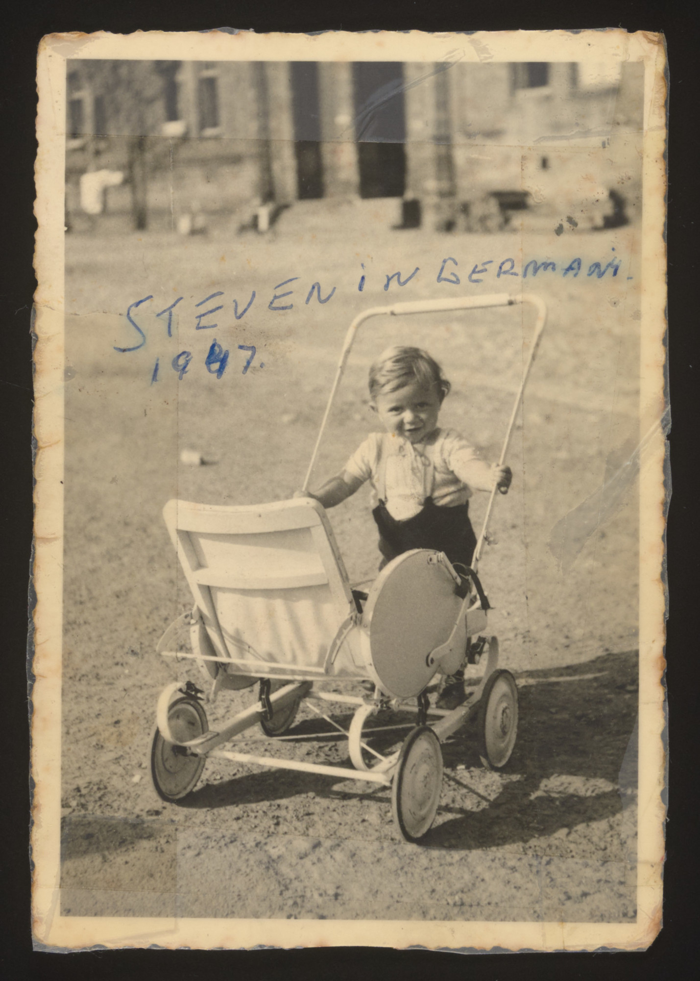 Stephen Bernat stands with a stroller in  the Bamberg displaced persons camp.
