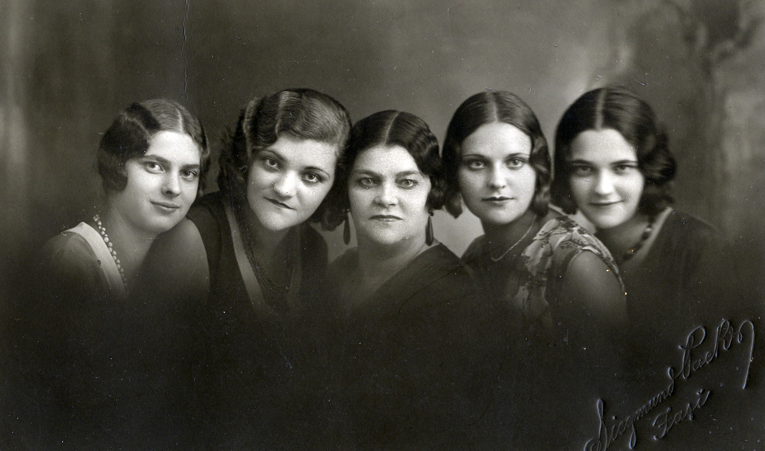 Studio portrait of a Jewish Romanian woman and her four daughters.  Pictured are Fanny Josef (center) and her daughers Maretta, Pepita, Freida, and Charlotte (left to right).