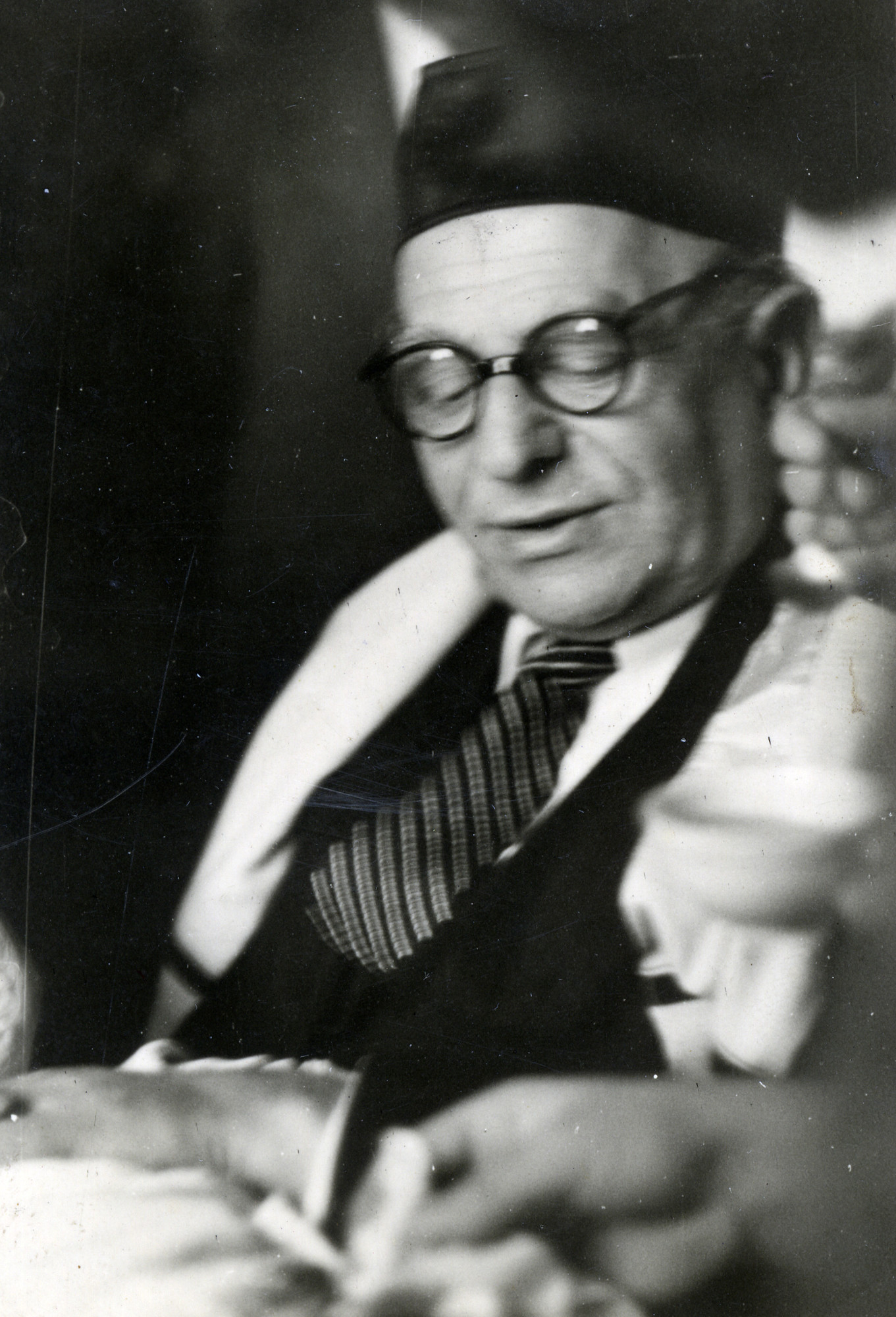 Close-up portrait of Eliezer Josef wearing a tallis.