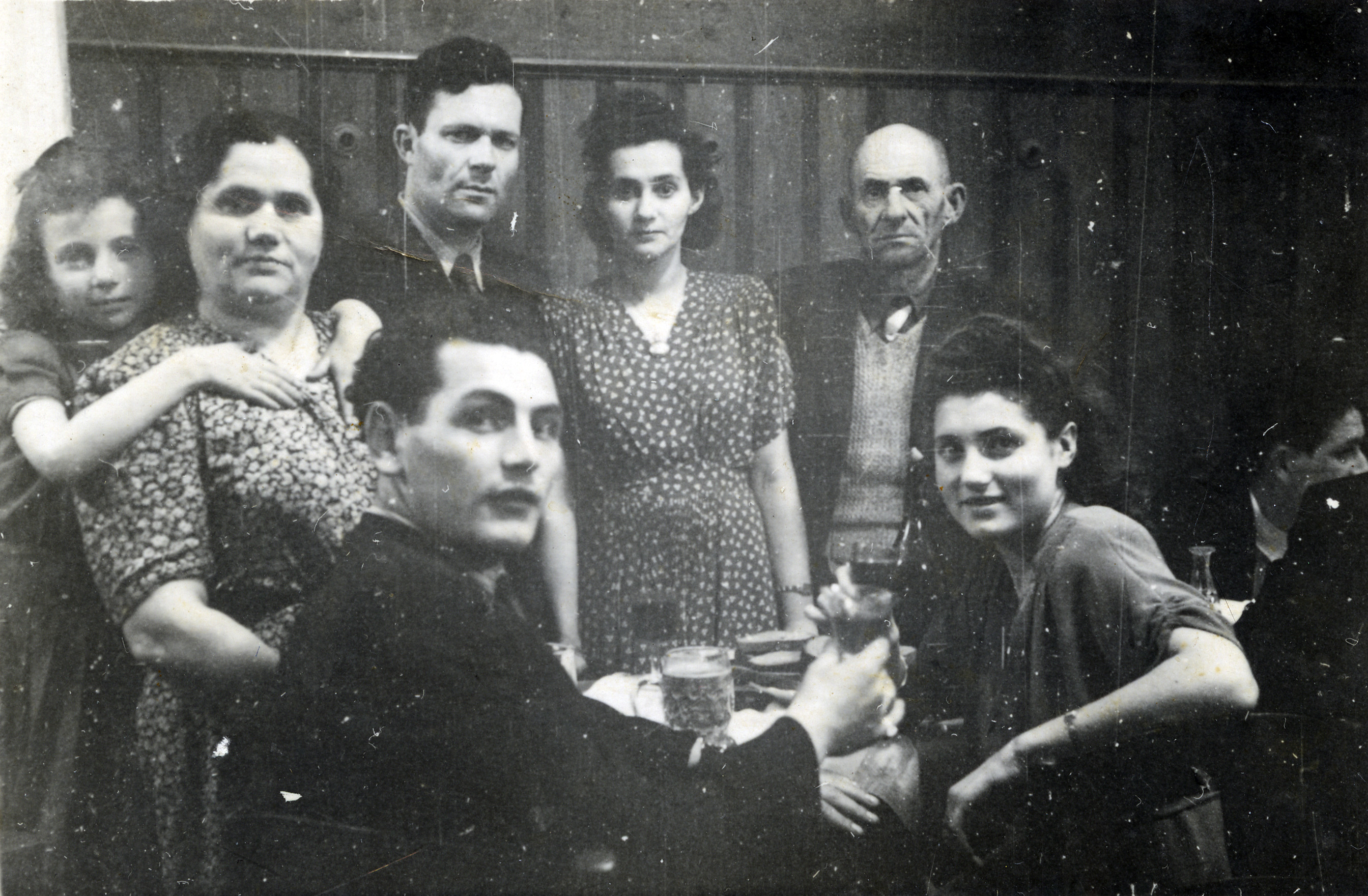 Guests at a wedding at the Heidenheim displaced persons camp.  Pictured are the bride and groom, Rachel  and Zalman (back, center); Raya and her husband Israel Eisenman, who survived Auschwitz (front); Zippora and her grandmother Fania (first and second from the left); and Shlomo Rochman, Zippora's grandfather's brother, who lost his wife and children in Auschwitz.