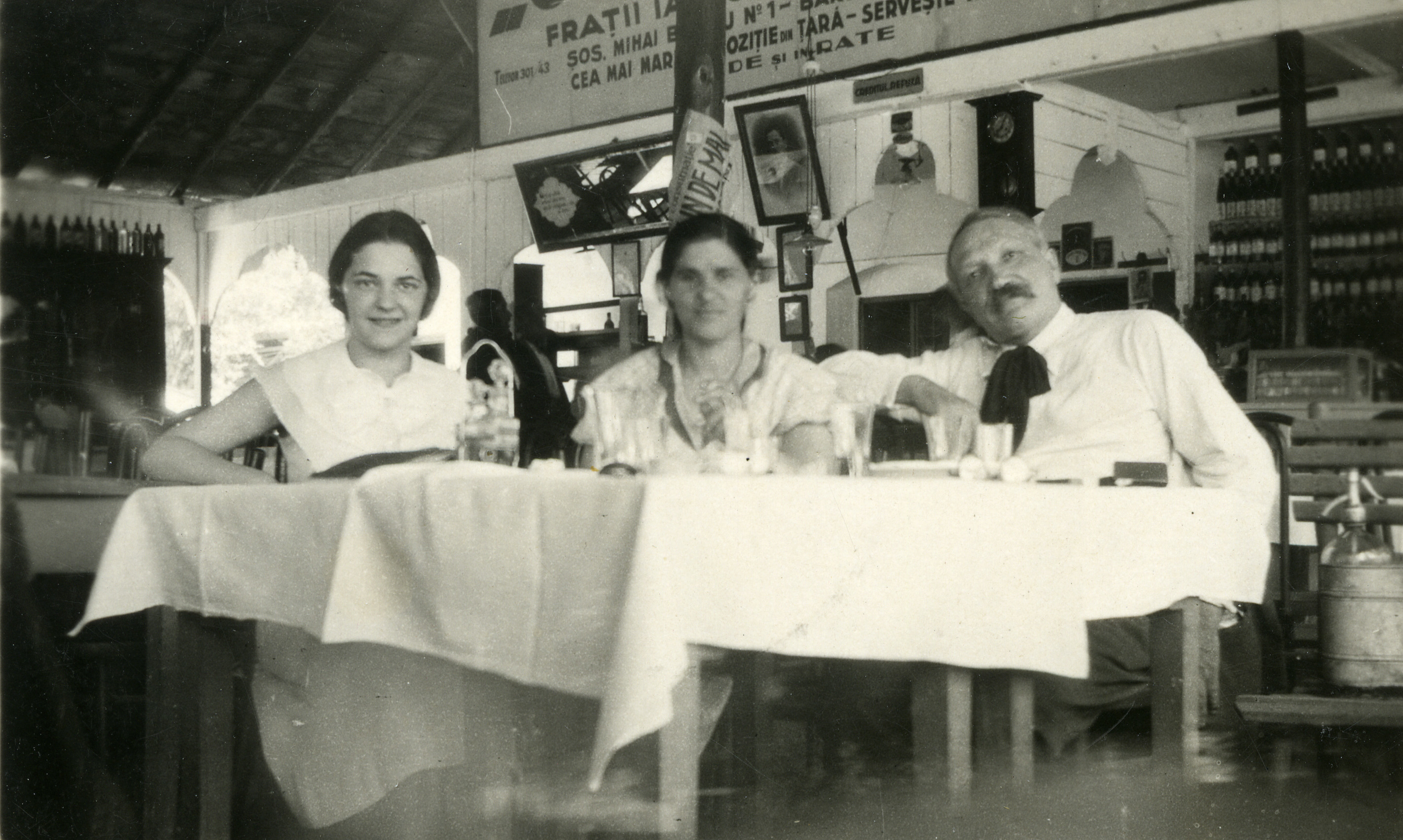 Romanian family members meet to discuss socialist party matters in a cafe.  Pictured are Charlotte Josef (left), Dr. Leon Gelehrter (right), and his wife (center).