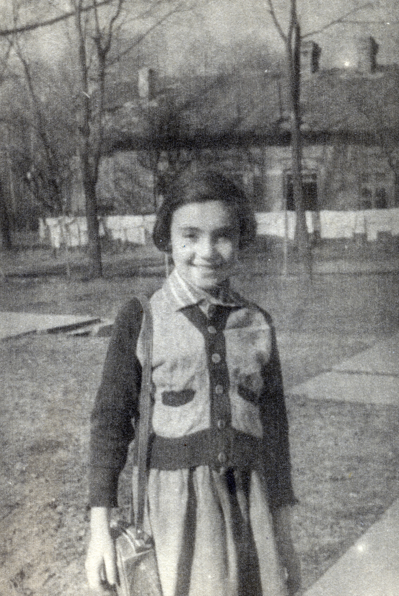 Leah Alterman stands outside an orphanage in Warsaw shortly after the end of the war.