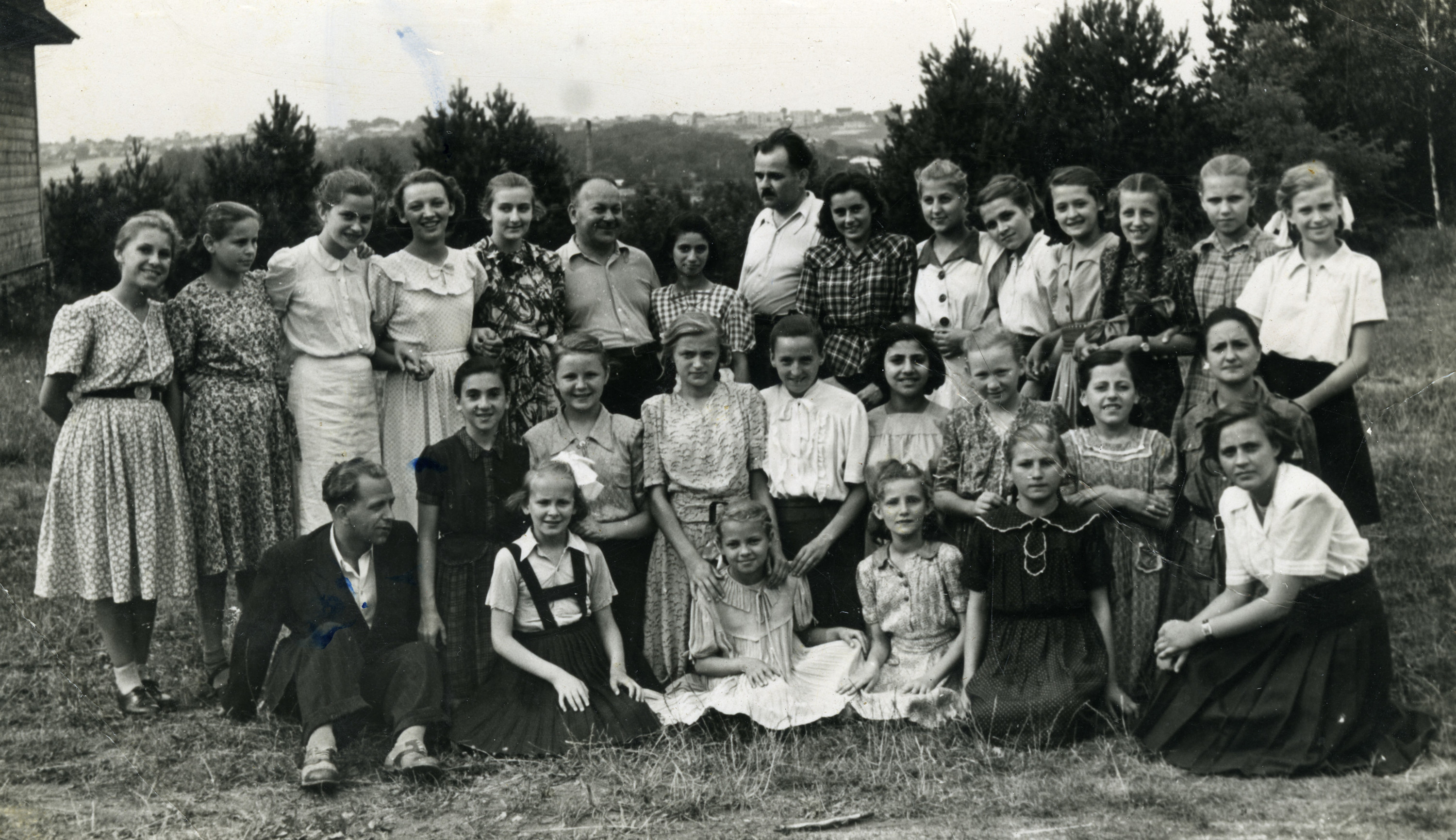 Children living in an orphanage in Warsaw, on vacation after the war.  Among those pictured is Leah Altman (kneeling in middle row, far left).