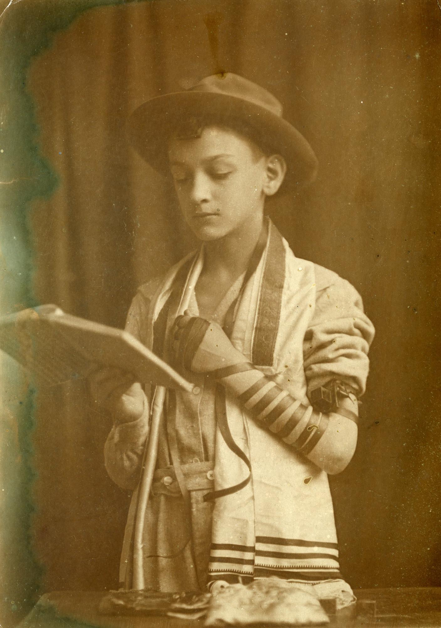 Moni Gelehrter, wrapped in tallis and tefillin, at his bar mitzvah in Iasi.