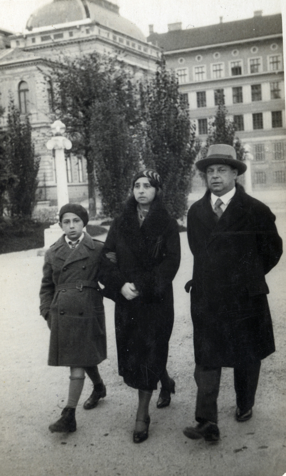 A Hungarian Jewish family walks down the street in Szeged.  Pictured are Aladar Honig and Irene (nee Banyai) Honig, with their son Stefan.