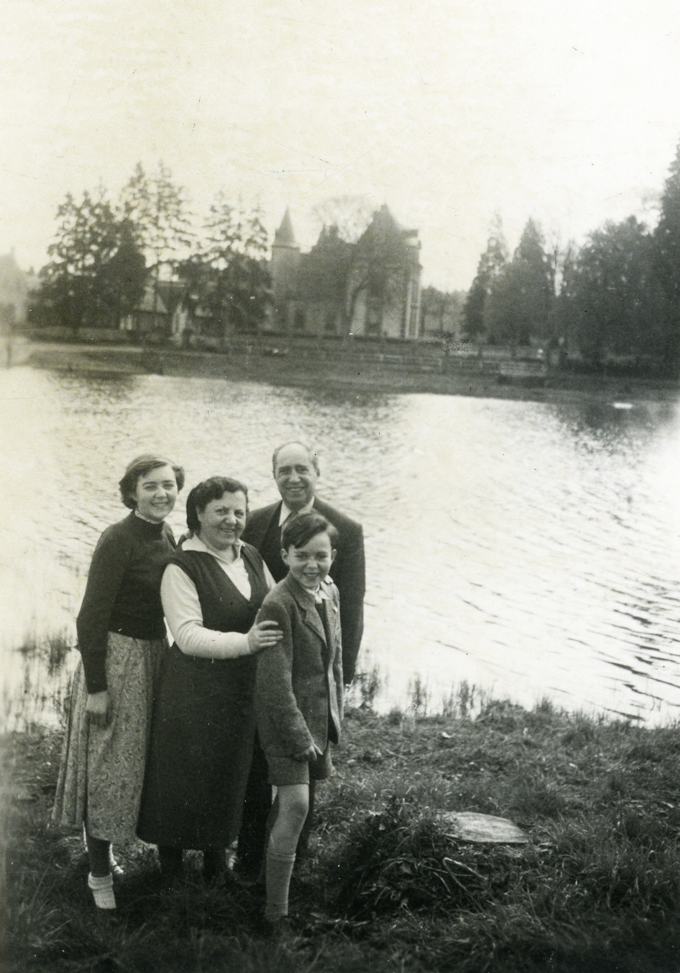 A Jewish family reunited after the war.  Pictured are Symchel and Clara Dores, and their children Mireille and Maurice.