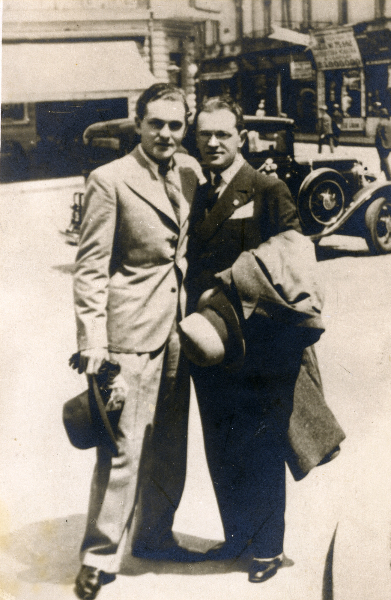 Jewish Romanian brothers pose together on the street in Bucharest.    Pictured are Marcel and Neumann Josef.