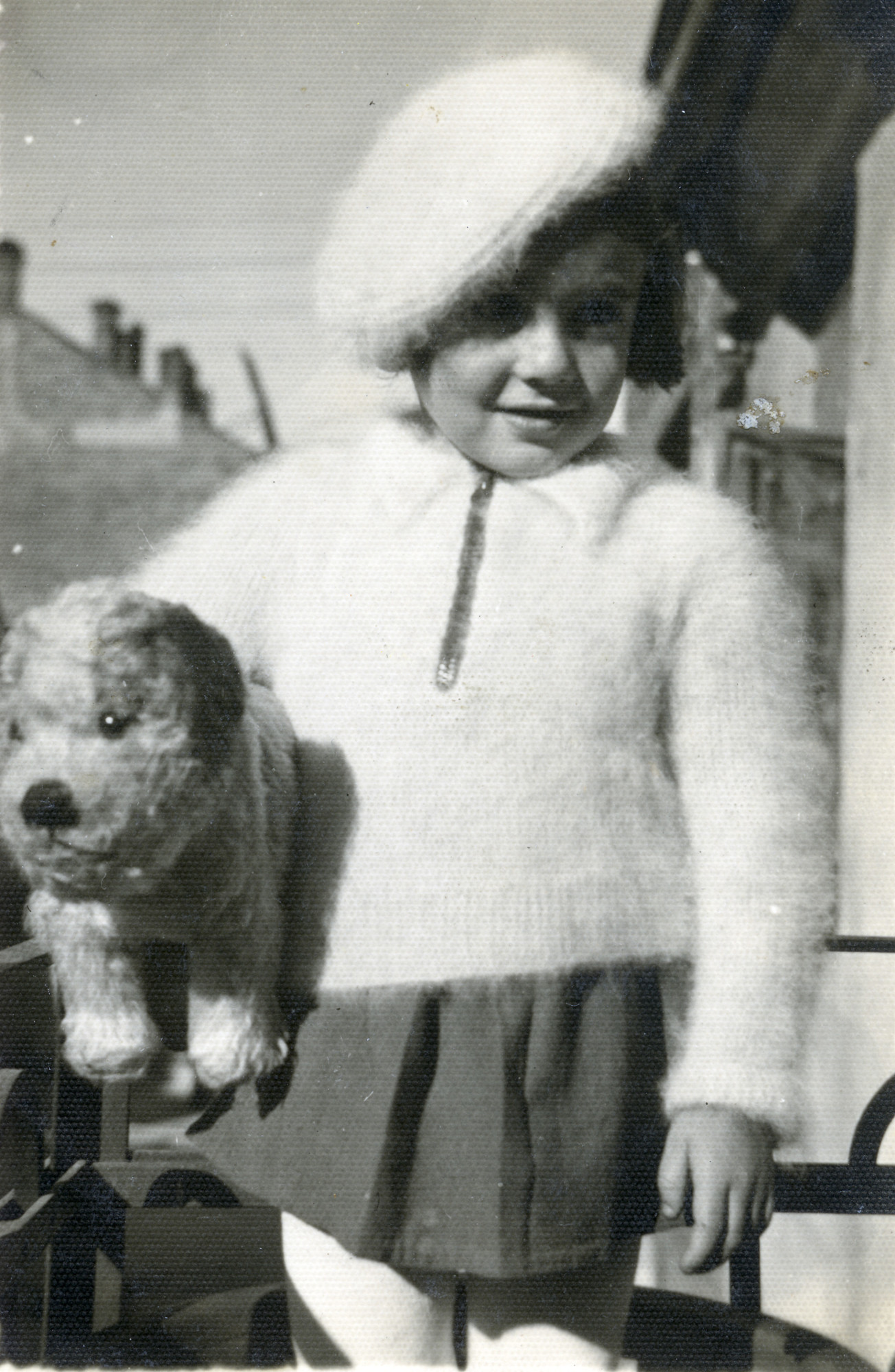Leah Alterman poses, holding her stuffed animal prior to going into hiding.