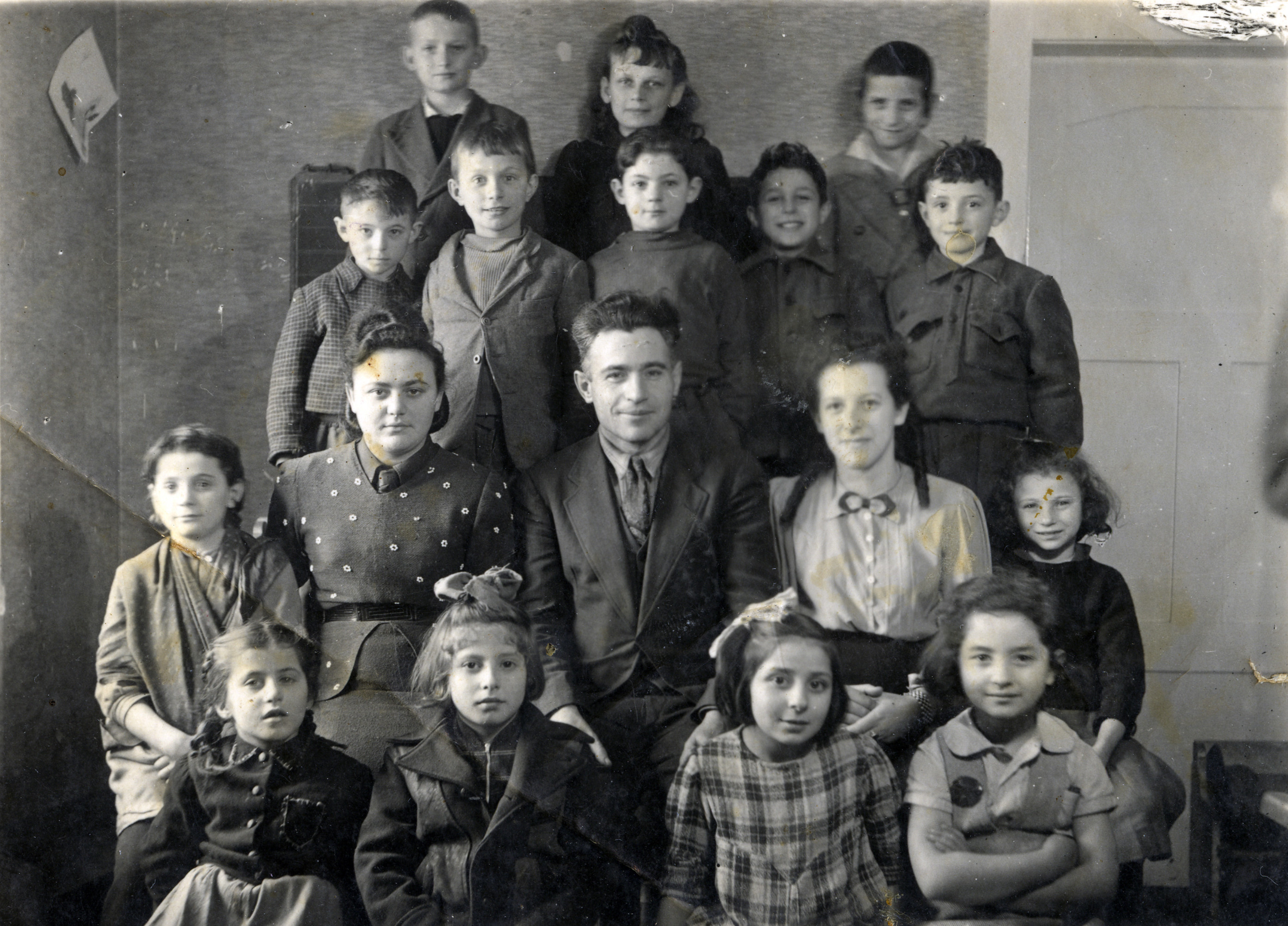 Group portrait of a school in Heidenheim displaced persons camp.  Among those pictured is Zippora Golomb (second row, far right).  The teachers are pictured in the middle.