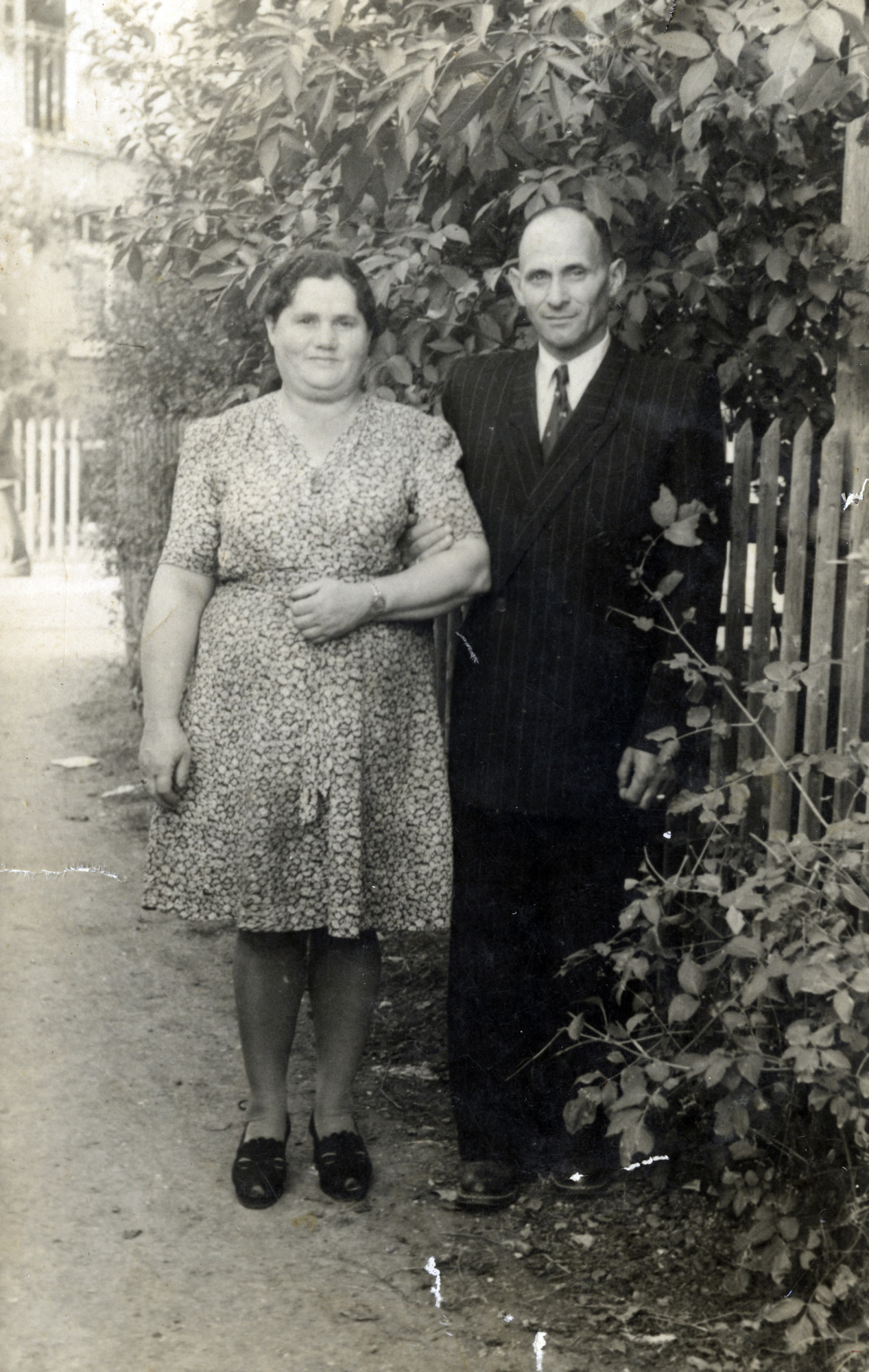 A Polish Jewish couple outside their house in the Heidenheim displaced persons camp.  Pictured are Fania and Avram and Rochman.
