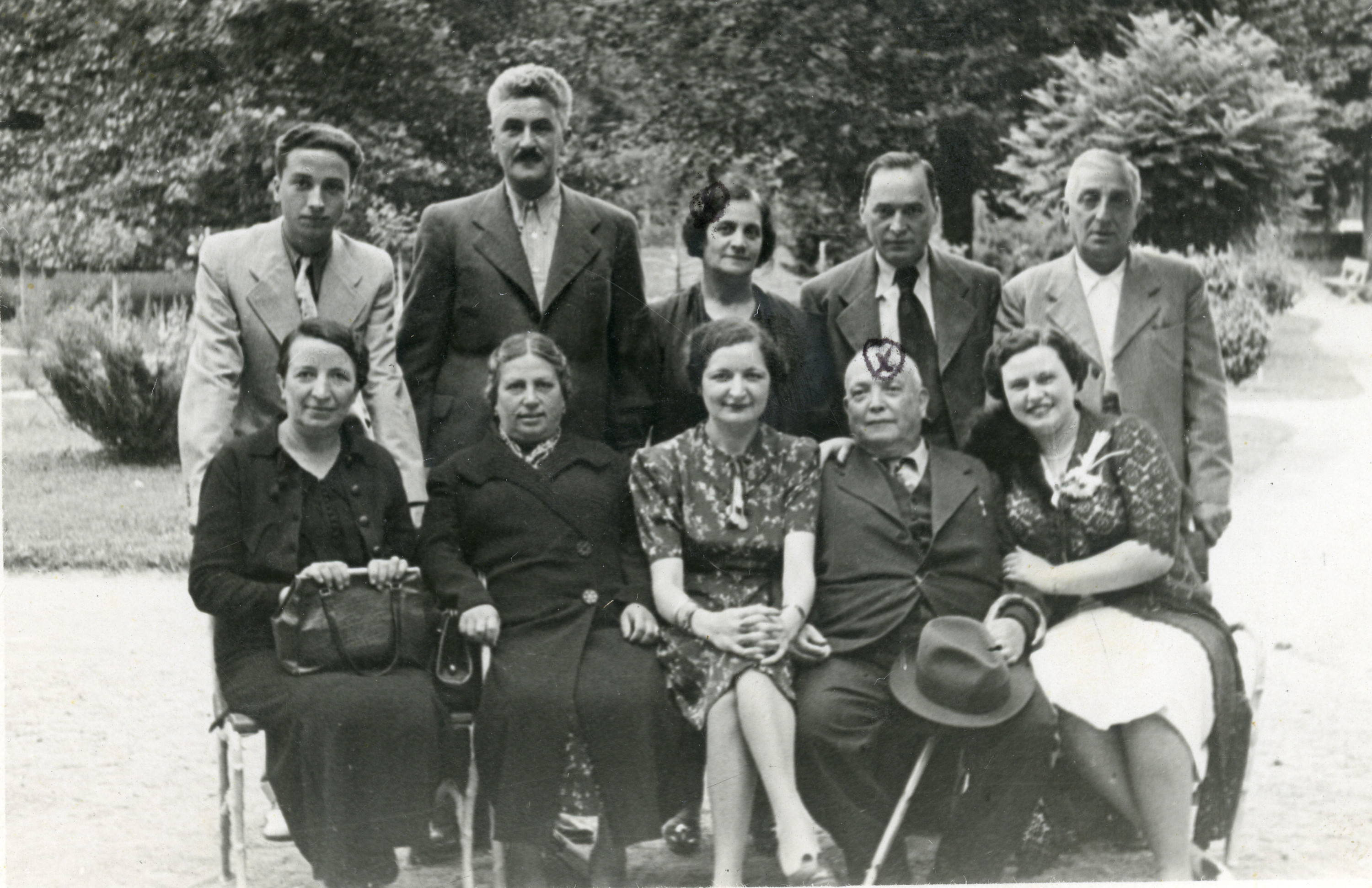 Group photograph of members of the Francesca (Fransevic) and Negrin families, probably in Skopje.   Among those pictured are Asher Francesca (front row, second from right) and his wife Esther (back row, middle), the grandparents of the donor.