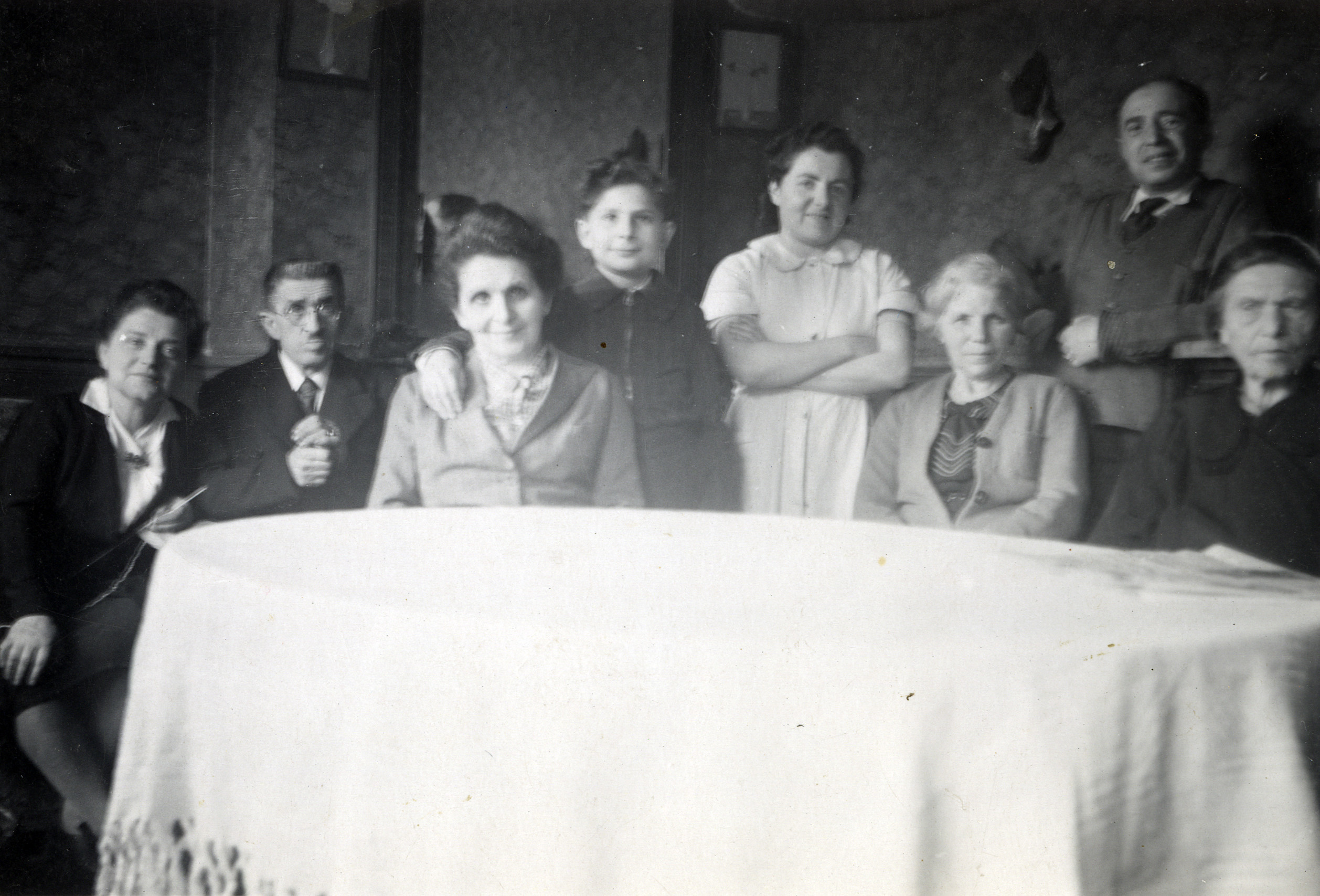 Wartime photograph of a French Jewish family.  Before the war, the Dores and Abramovitz families frequenlty socialized together on Sundays.  This photograph shows the last occasion when they were able to do so.  Three members of the family had already been deported to Auschwitz:  Marcel Tachnoff (father of Claude, pictured), Meyer Lipovetski (brother of Adolphe, pictured), and Dora Abramowitz (mother of Clara, pictured).  Pictured are (left to right):  Alice (sister to Clara) and her husband Adolphe Lipovitski, Anna Tachnoff (sister to Clara) and her son Claude, Clara, Celine Lipvitski (aunt?), Symchel Dores,and his mother Zizla Dores.