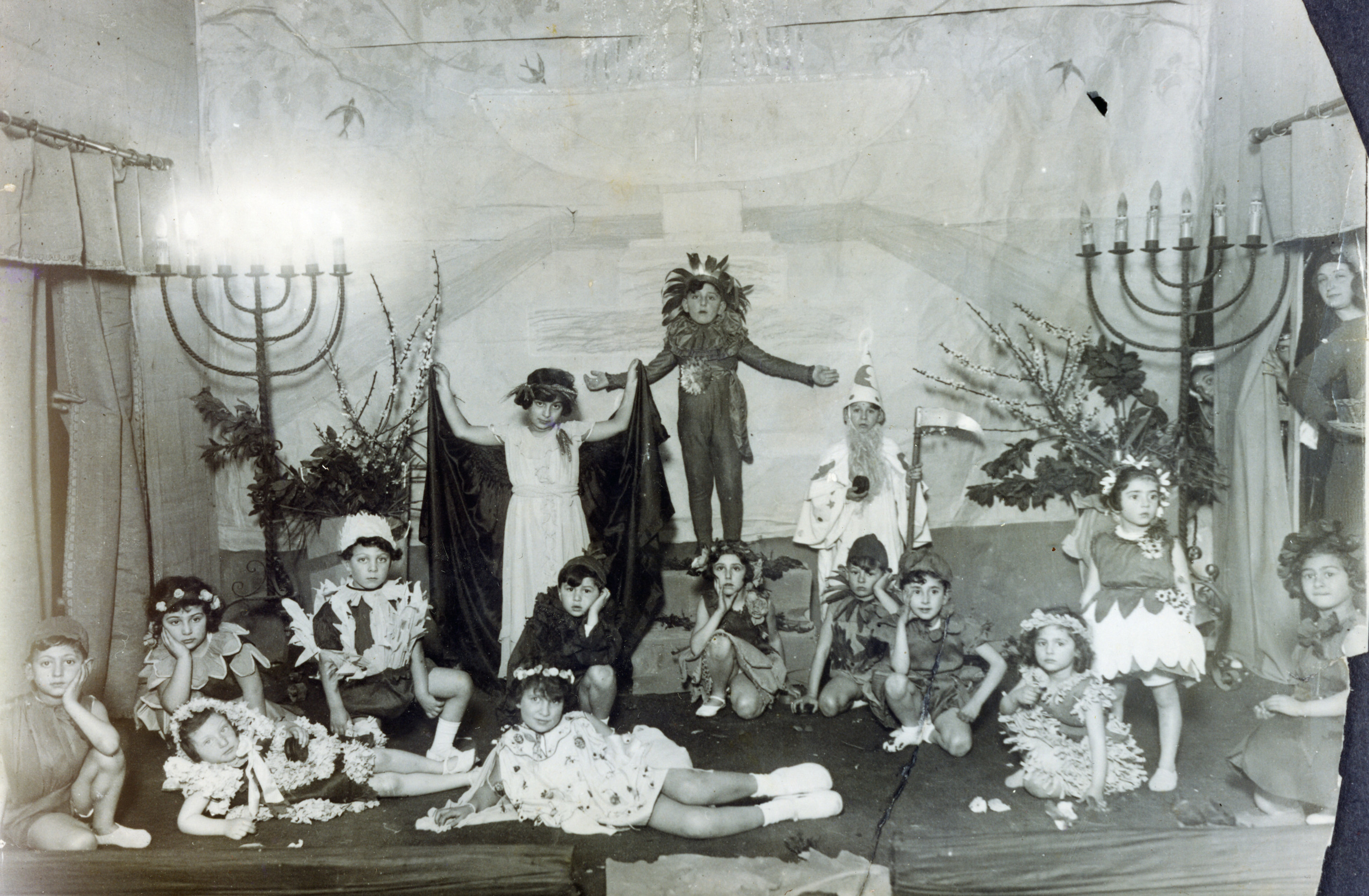 Italian Jewish children take part in a play to celebrate Shavuot.  Amont those pictured is Emma Di Capua (seated, third from the right).