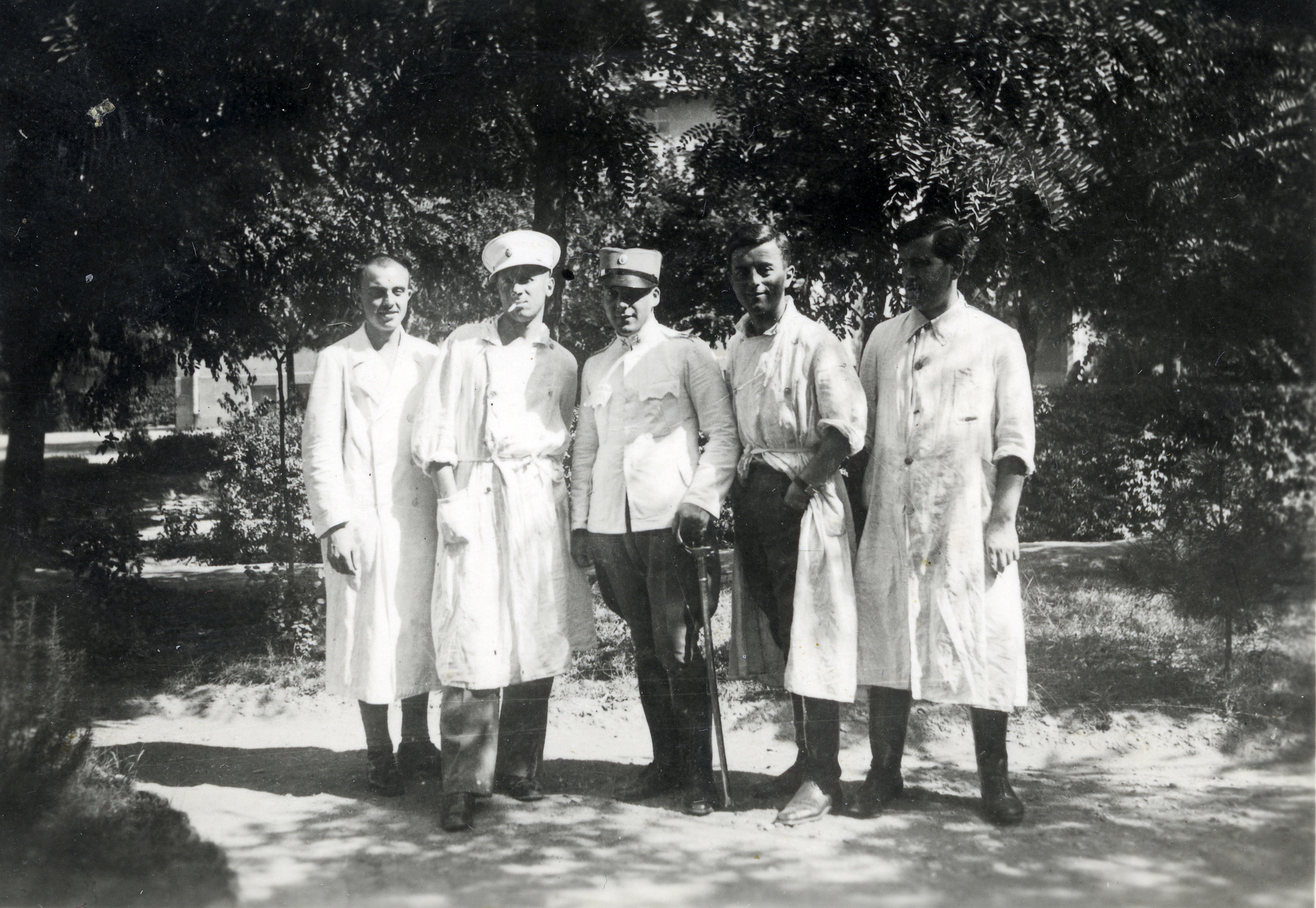 Group portrait of members of the Army Medical Corps in Yugoslavia.  Among those pictured (center) is Elio Fransevic, a Jewish pharmacist who was pulled from the Monopol Tobacco Factory prior to deportation to Treblinka, and drafted into the medical corps.