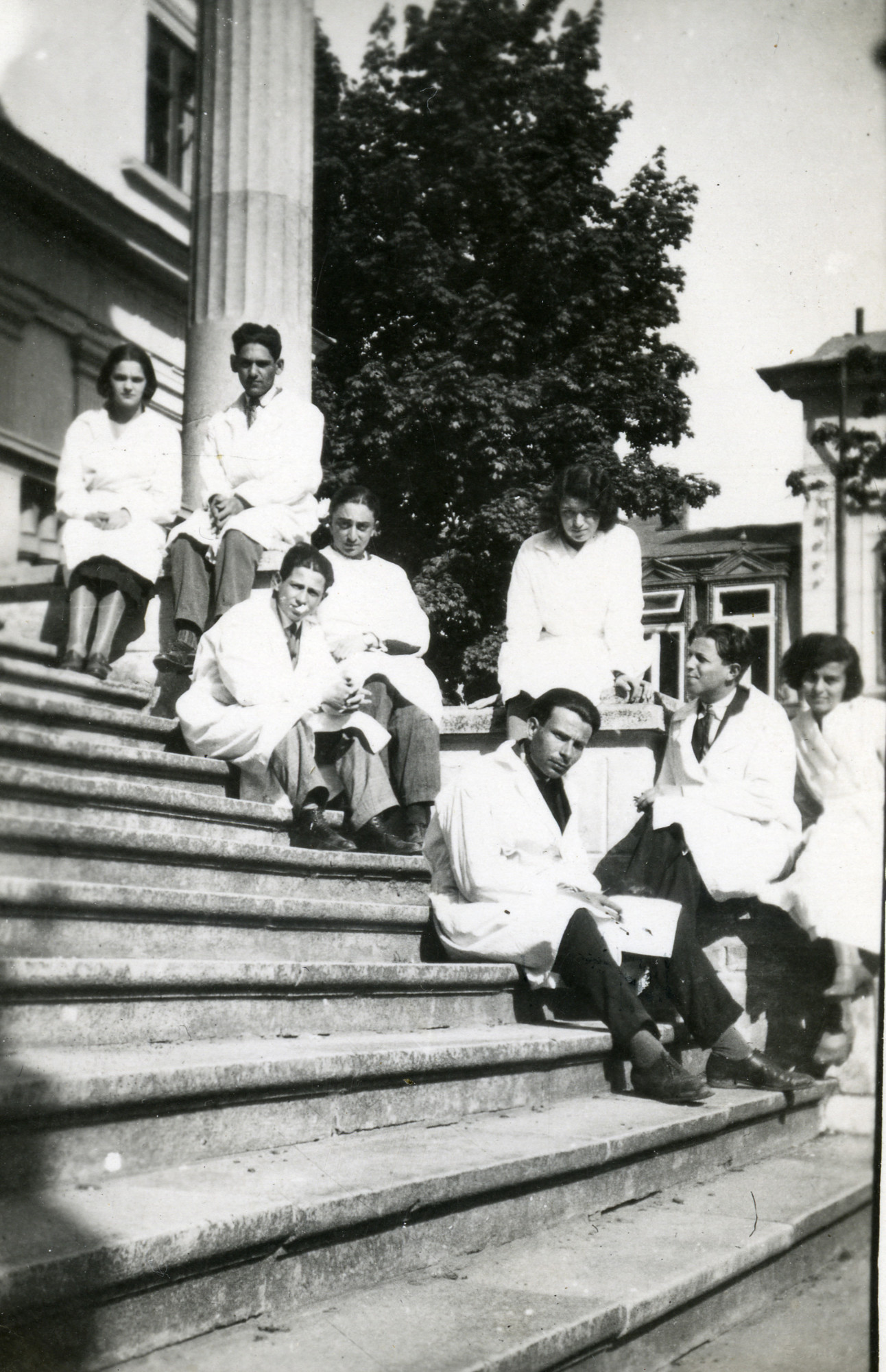 A Jewish Romanian woman poses on an outdoor stairwell with her medical school classmates.   Among those pictured is Charlotte Josef (far left).