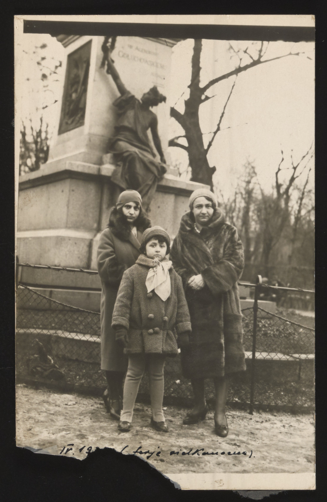 Salomea (right) and Judyta (center) Sobel pose in front of a statue in Lvov  together with an unidentified woman.
