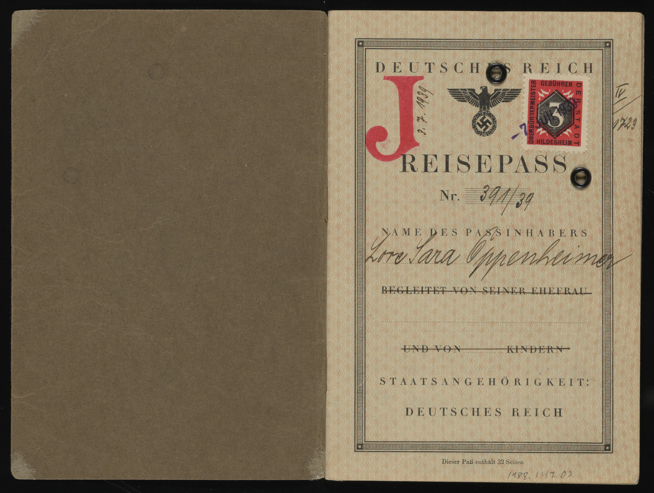 """A passport issued to Lore Oppenheimer, that was stamped with the letter """"J"""" for """"Jude.""""  The name """"Sara"""" was added for all German-Jewish women in accordance with German legislation."""