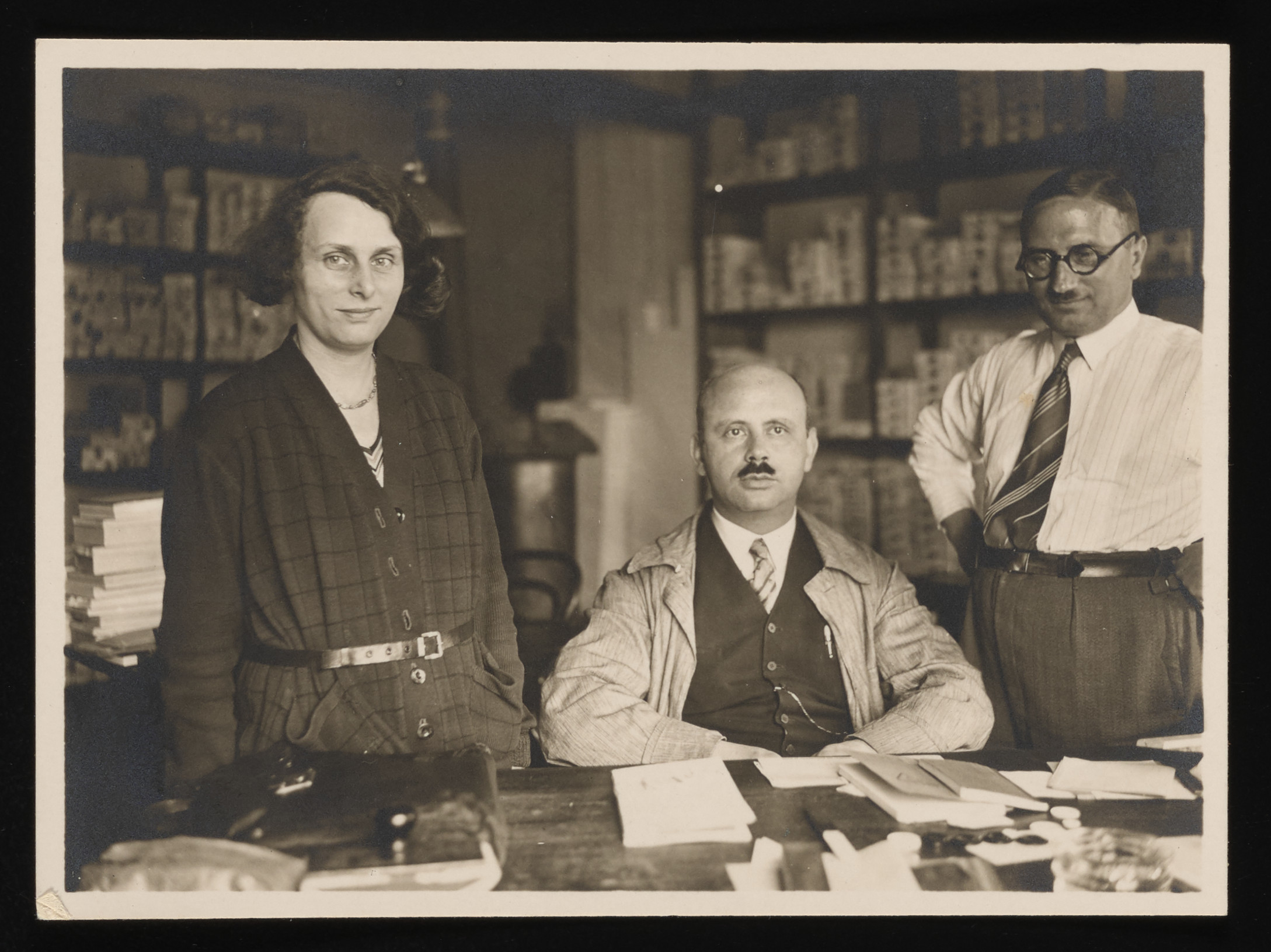 """Three administrators of the Glade und Freyer"""" button factory """" on Wall Strasse pose in the factory office.   Pictured from the left to right are Paula Freyer (donor's aunt), her brother Leo Freyer (donor's father), and Paul Hermann."""
