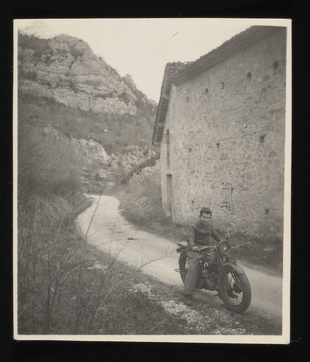 Swiss counselor, Max Schanehtele rides his motorcycle near the Chateau de La Hille.