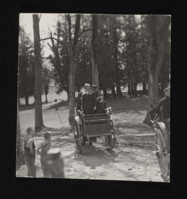 Heiri Kagi rides in a wooden cart on his way to his wedding the La Hille children's home.