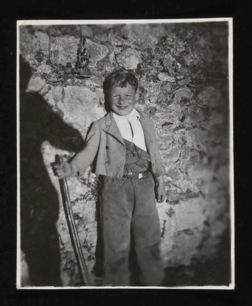 A French boy at the La Hille children's home holds a staff.