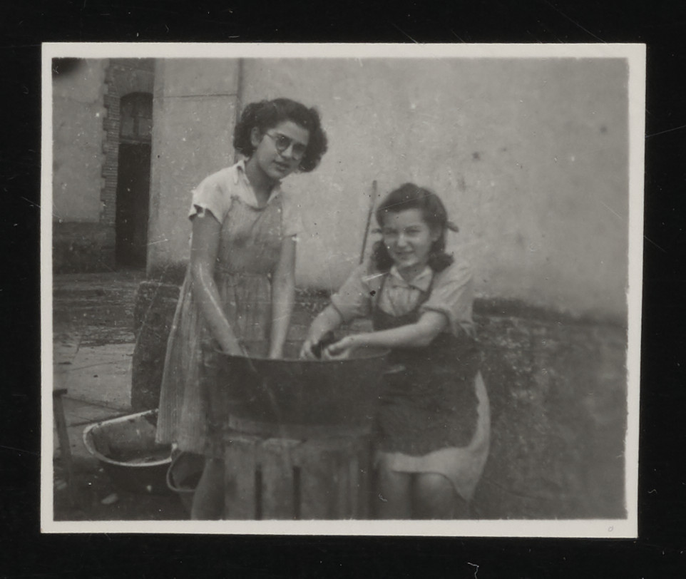 Rosa Goldmark and Cilly Stueckler do laundry in the La Hille children's home.