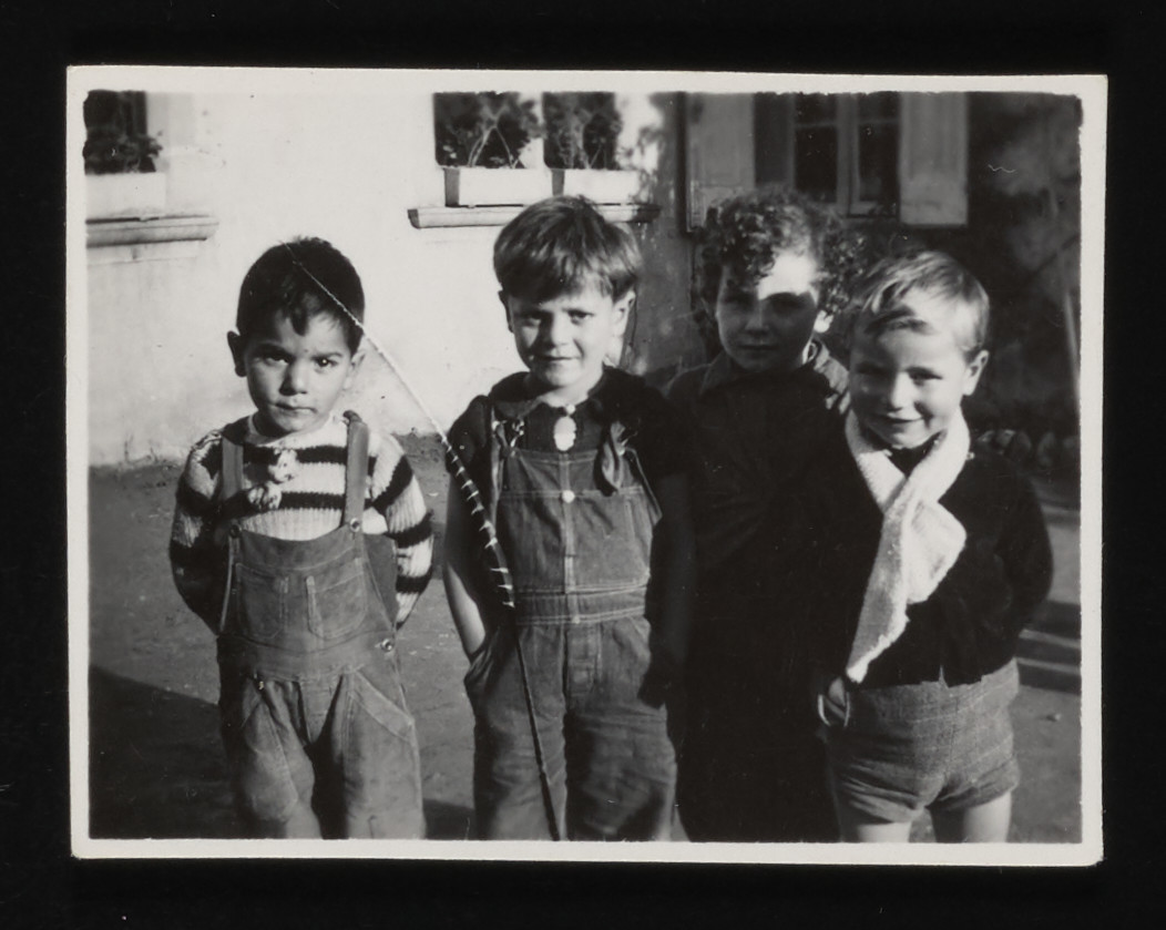 Close-up portrait of four younger boys pose at the La Hille children's home.