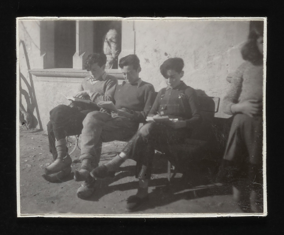 Three teenage boys sit and read in the La Hille children's home.   Pictured from left to right are Kurt Klein, Joseph Dortort, and Gerald Kowaczkowski.